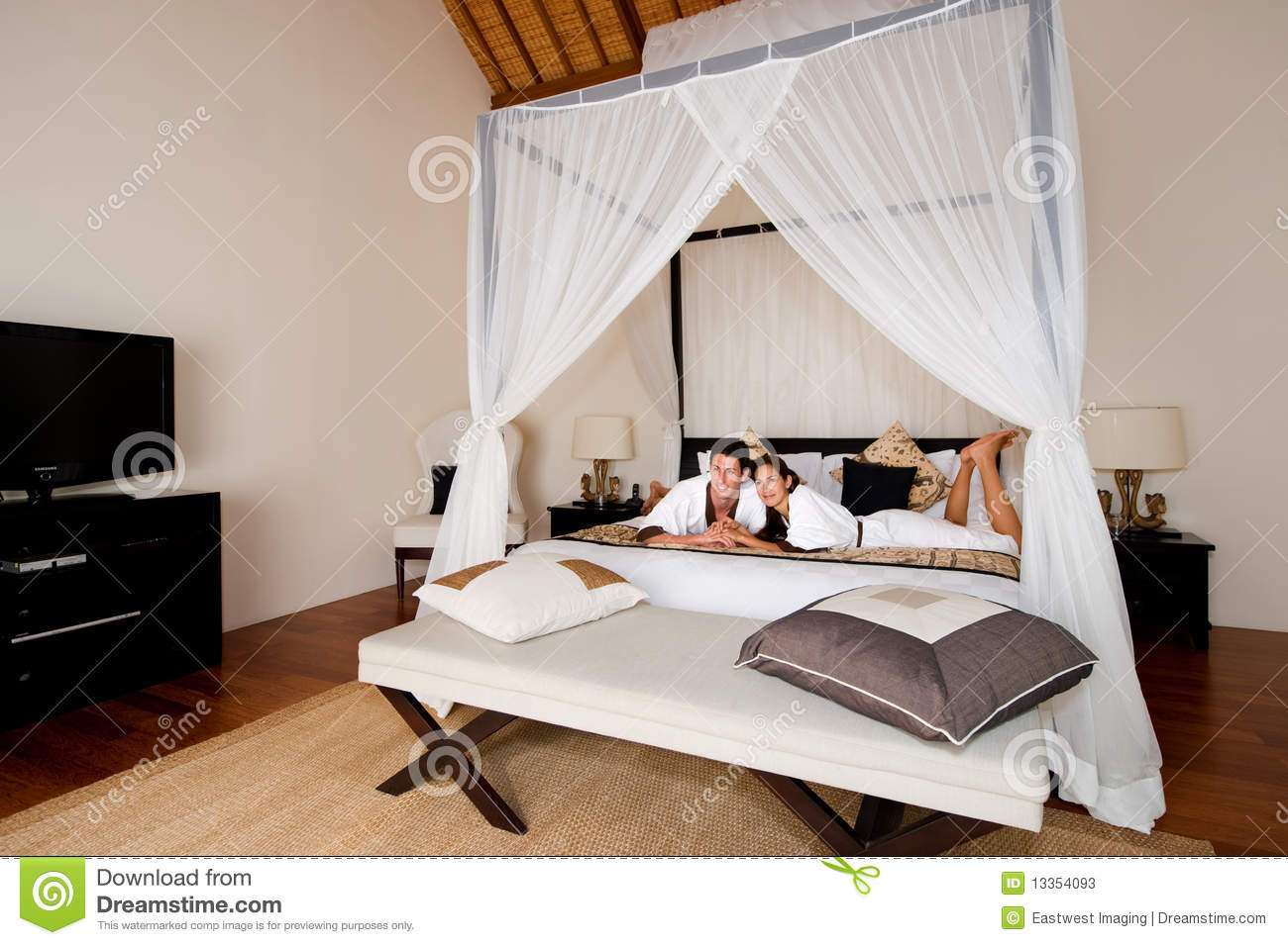 Couple Relaxing In Bedroom Stock Photos Image 13354093