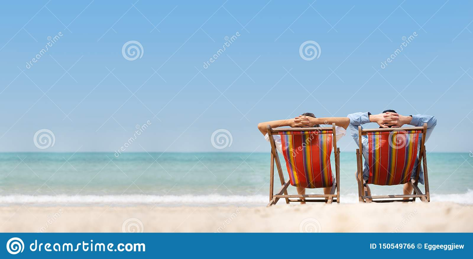 Couple relaxing on chair beach over sea background