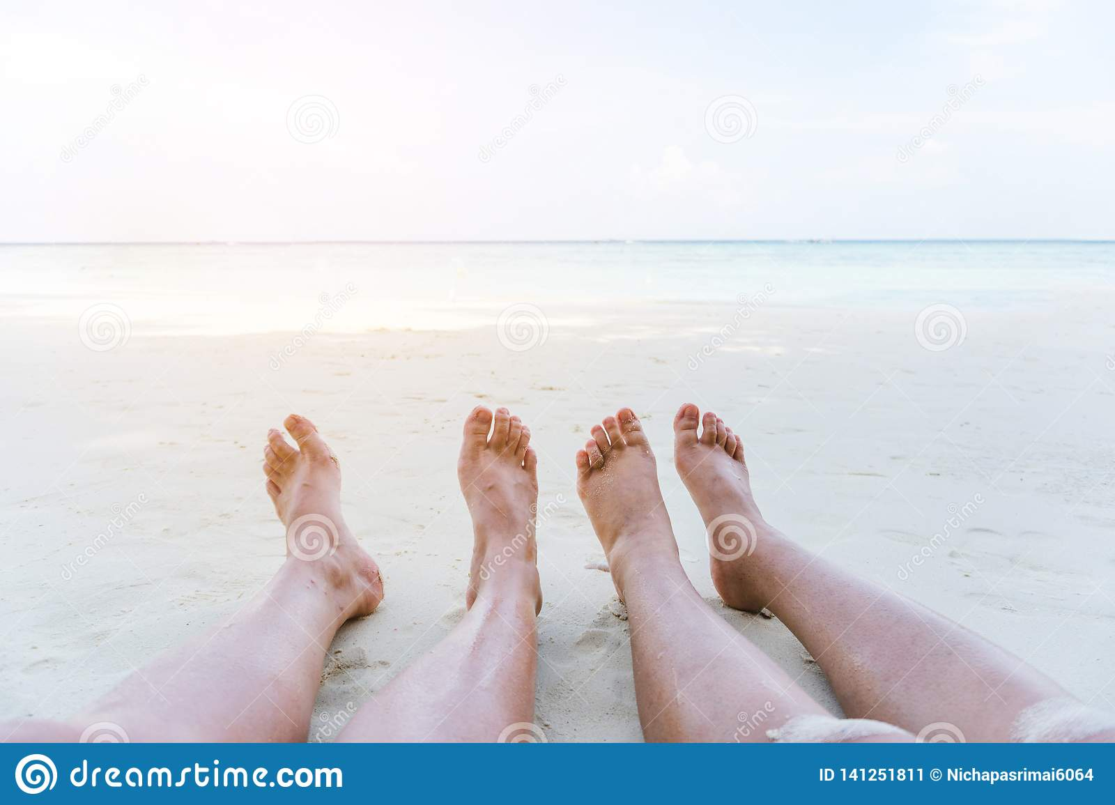 Couple relaxing in summer holiday on beach