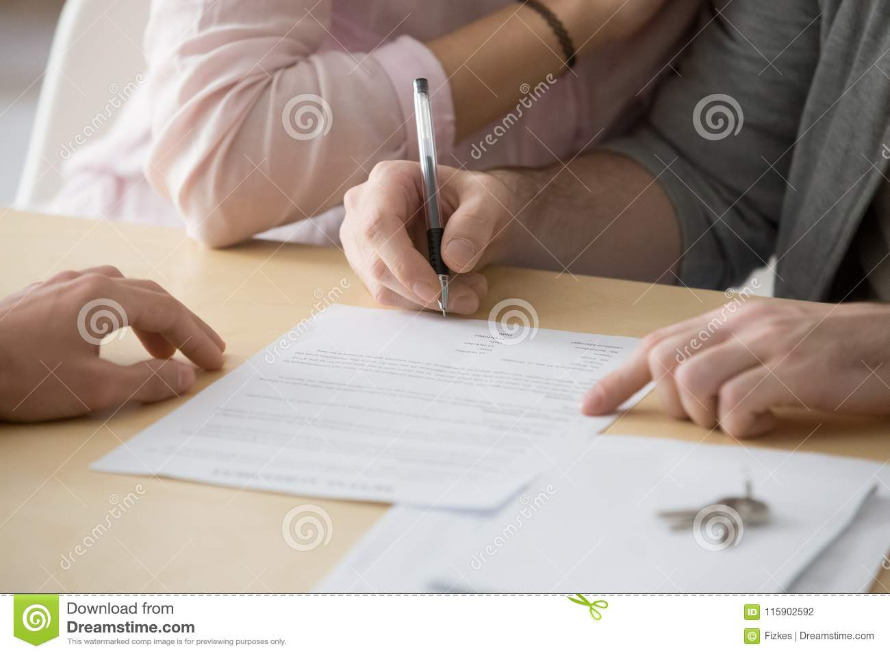 Couple Signing Rental Sale Purchase Agreement Buying Renting Hou