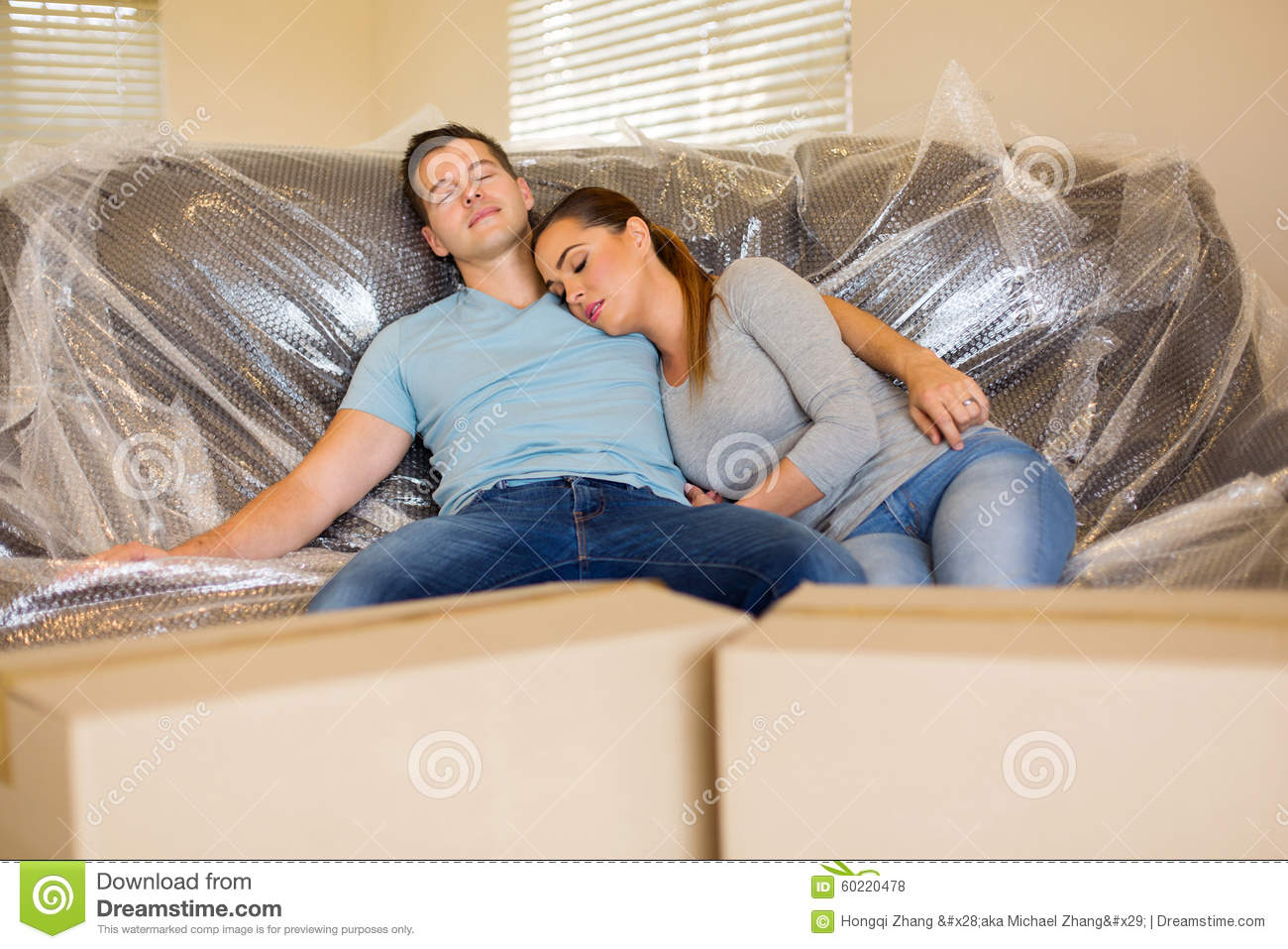 Couple resting on couch