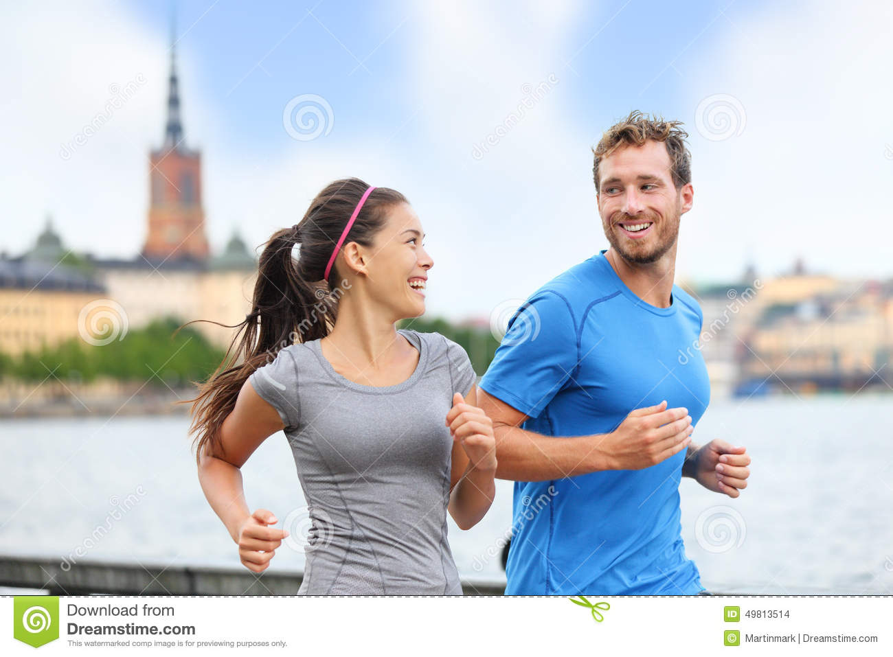 Couple runners running in Stockholm city, Sweden