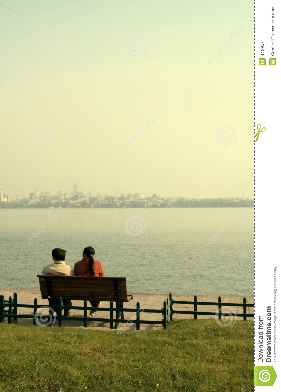 Couple Sat On Bench By Lake Royalty Free Stock Photography - Image ...