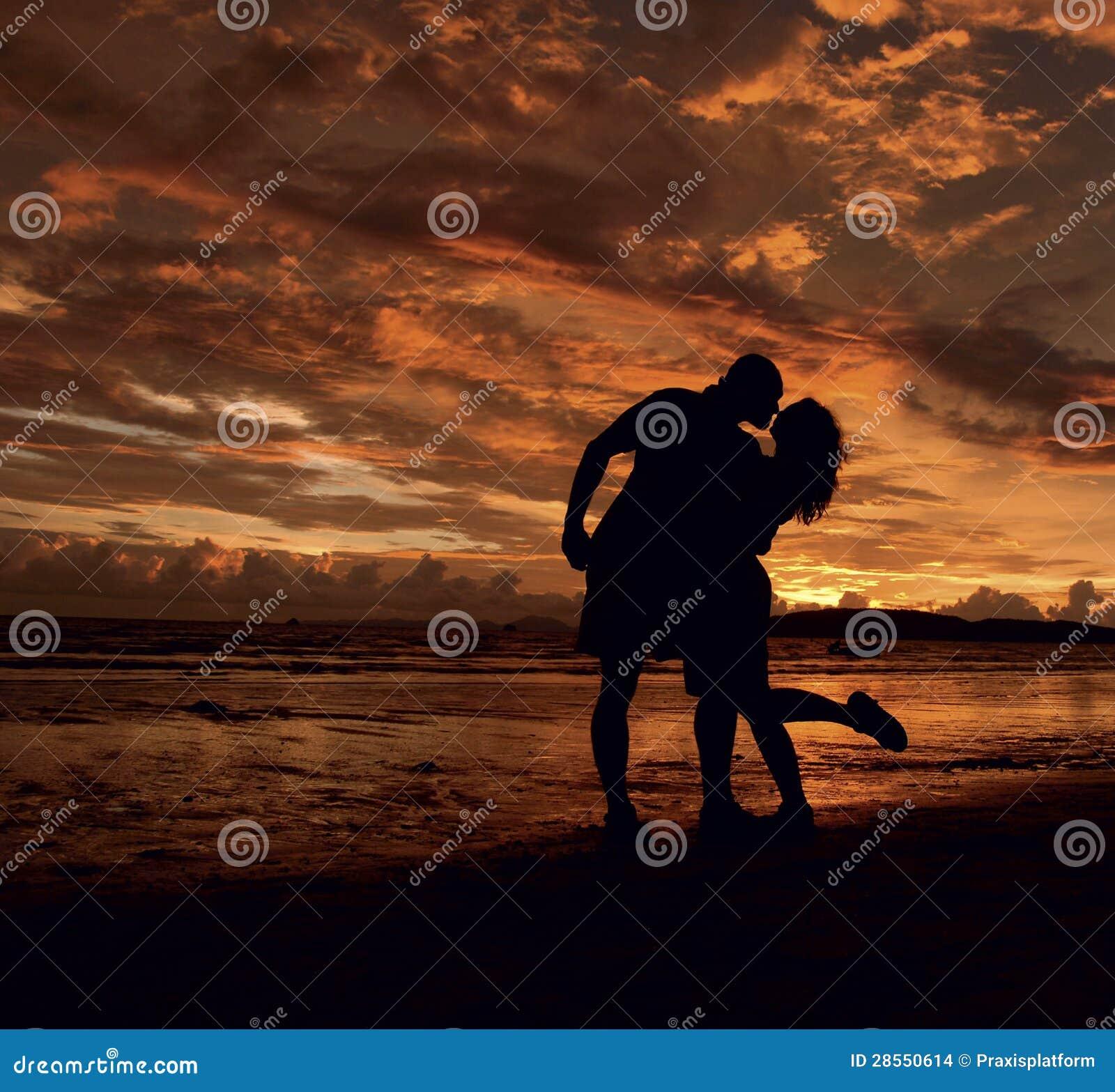 Couple Scene Of Love Sunset At The Beach Stock Photo