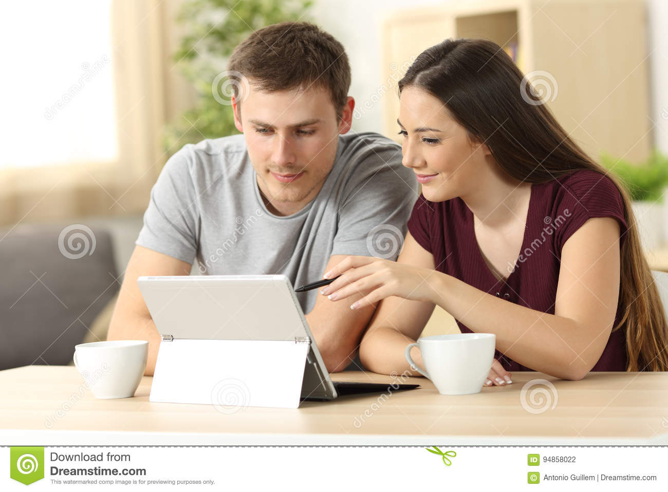 Couple searching on line with a tablet pc