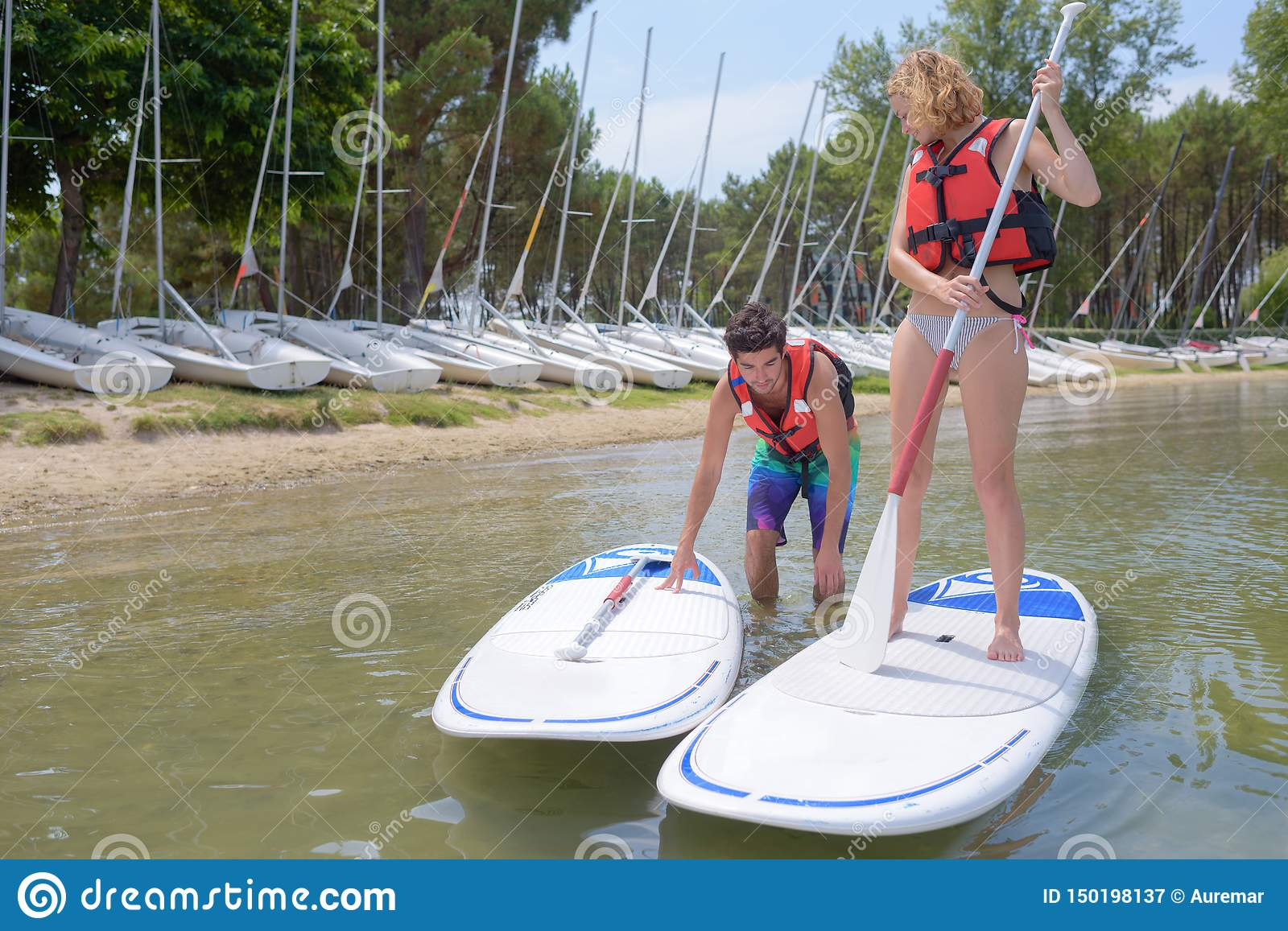 Couple setting off on windsurfing boards