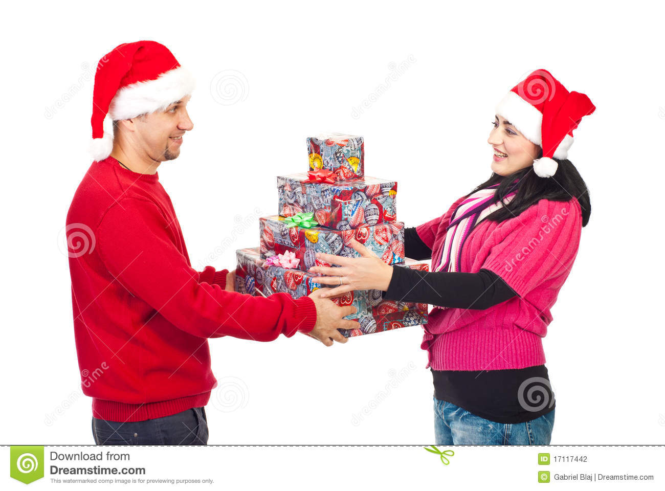 Couple Sharing Christmas Gifts Stock Photo - Image of husband, offer ...