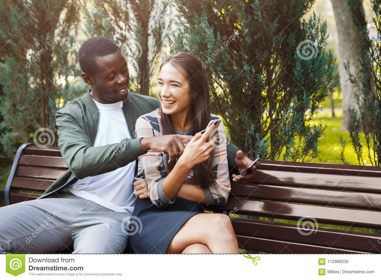 Couple sharing media in smartphone copy space