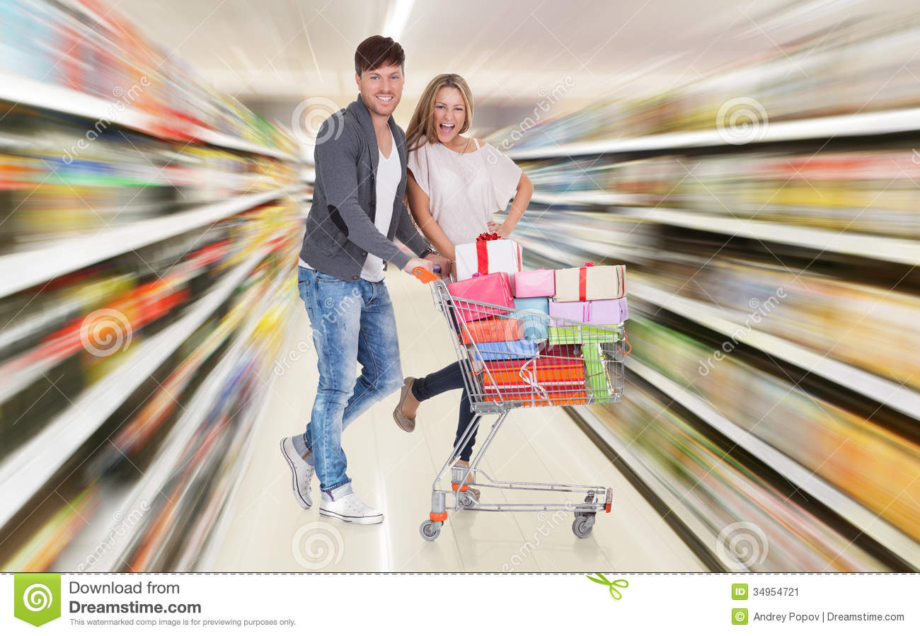 Couple With Shopping Cart stock image. Image of food - 34954721