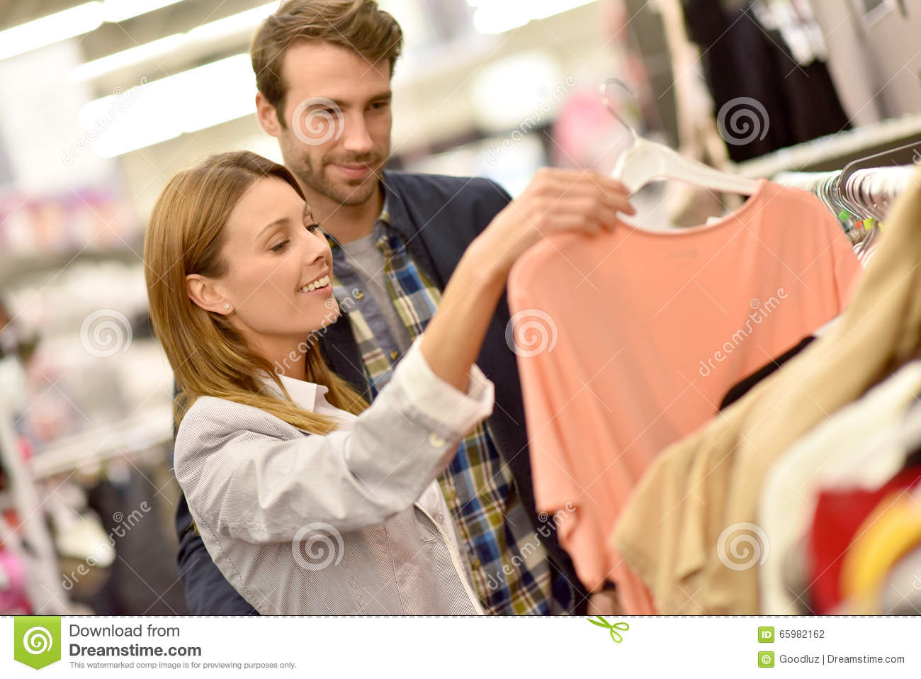 baa5989bec Couple shopping together in clothing store. More similar stock images
