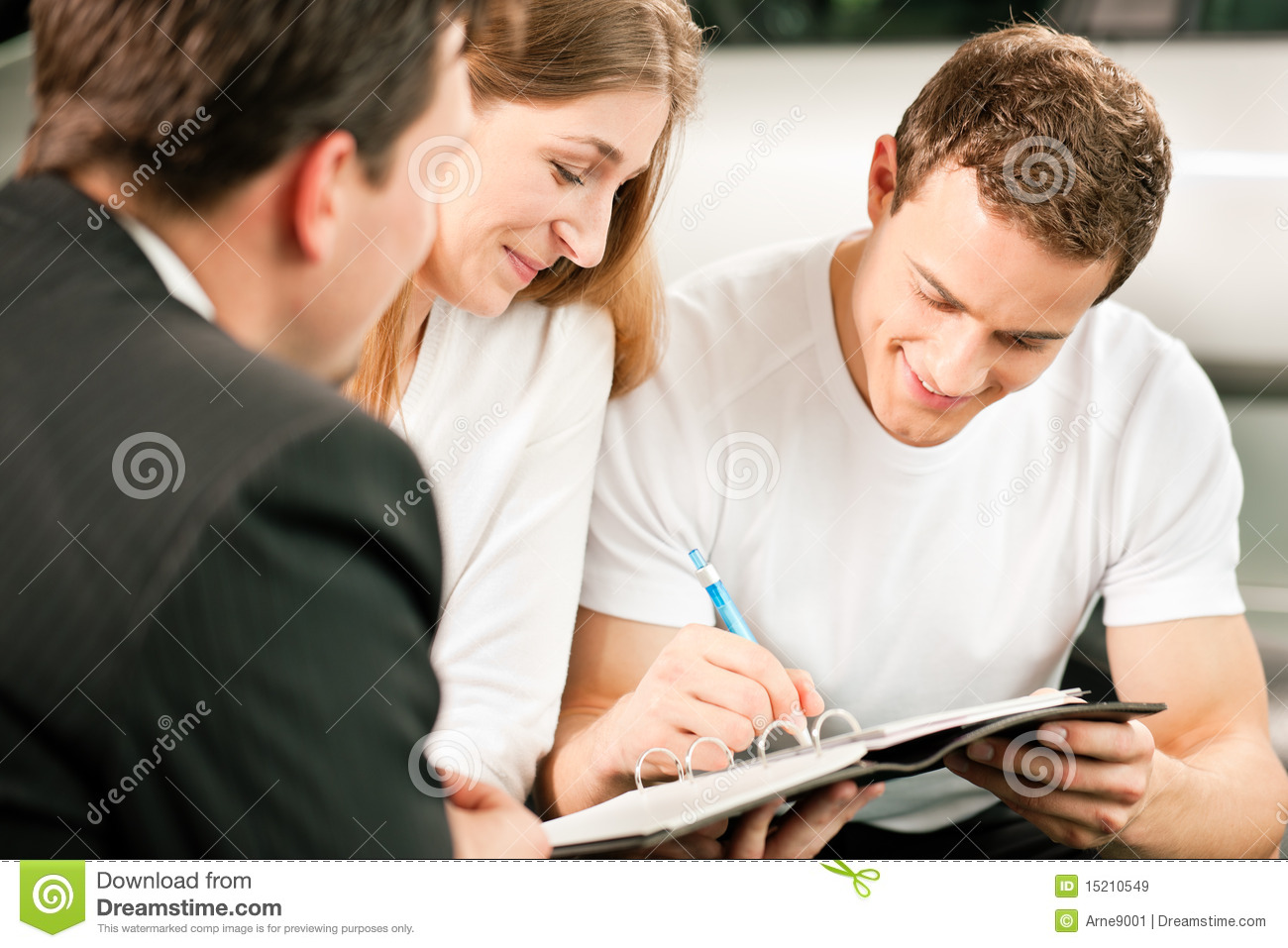couple signing sales contract at car dealer stock image image of