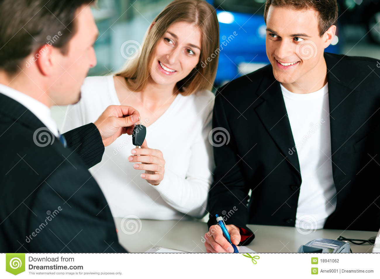 couple signing sales contract at car dealer stock photo image of