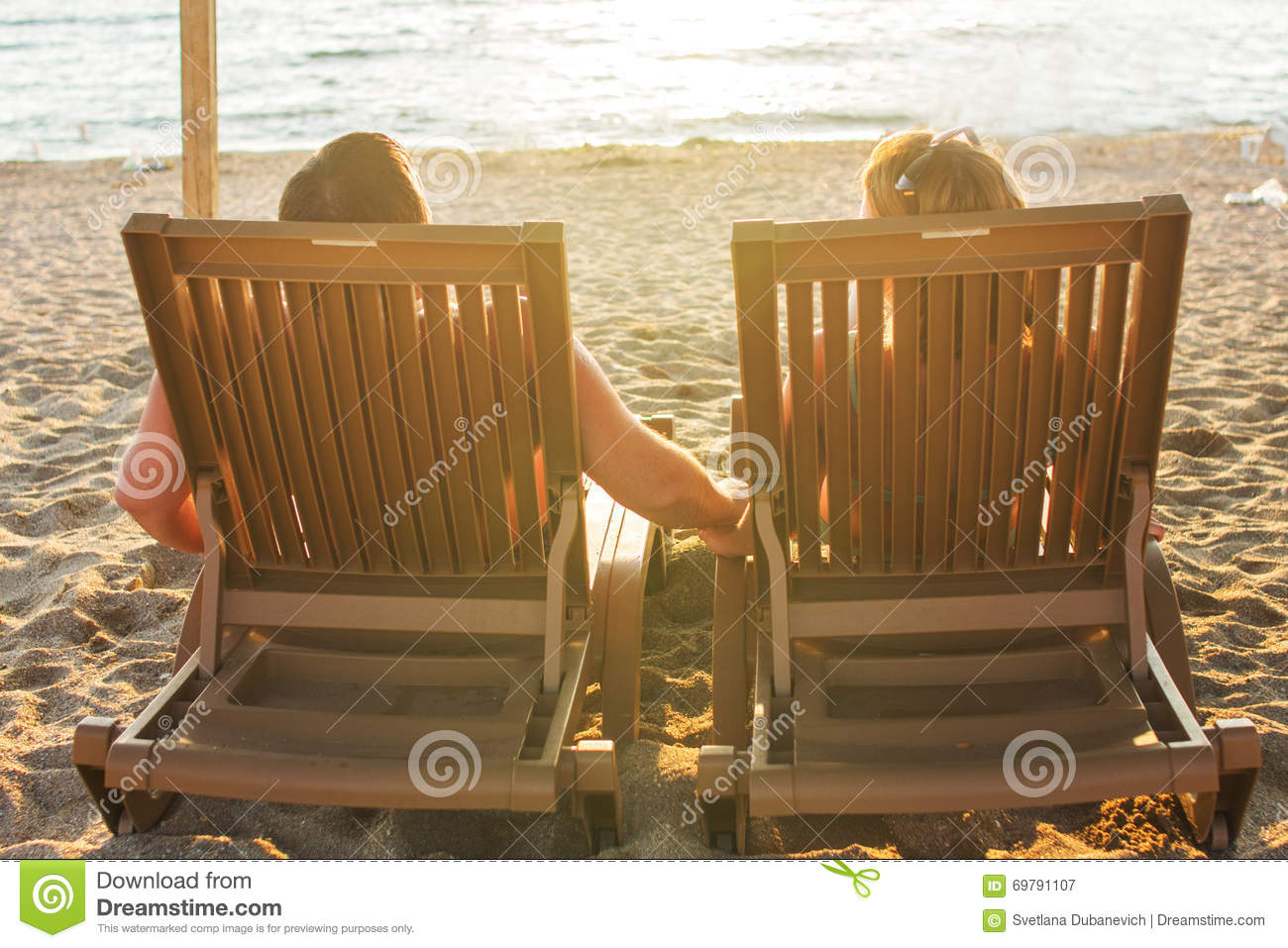 Couple Sitting On The Lounge Chairs Stock Image | CartoonDealer.com #69791107 & Couple Sitting On The Lounge Chairs Stock Image | CartoonDealer.com ...