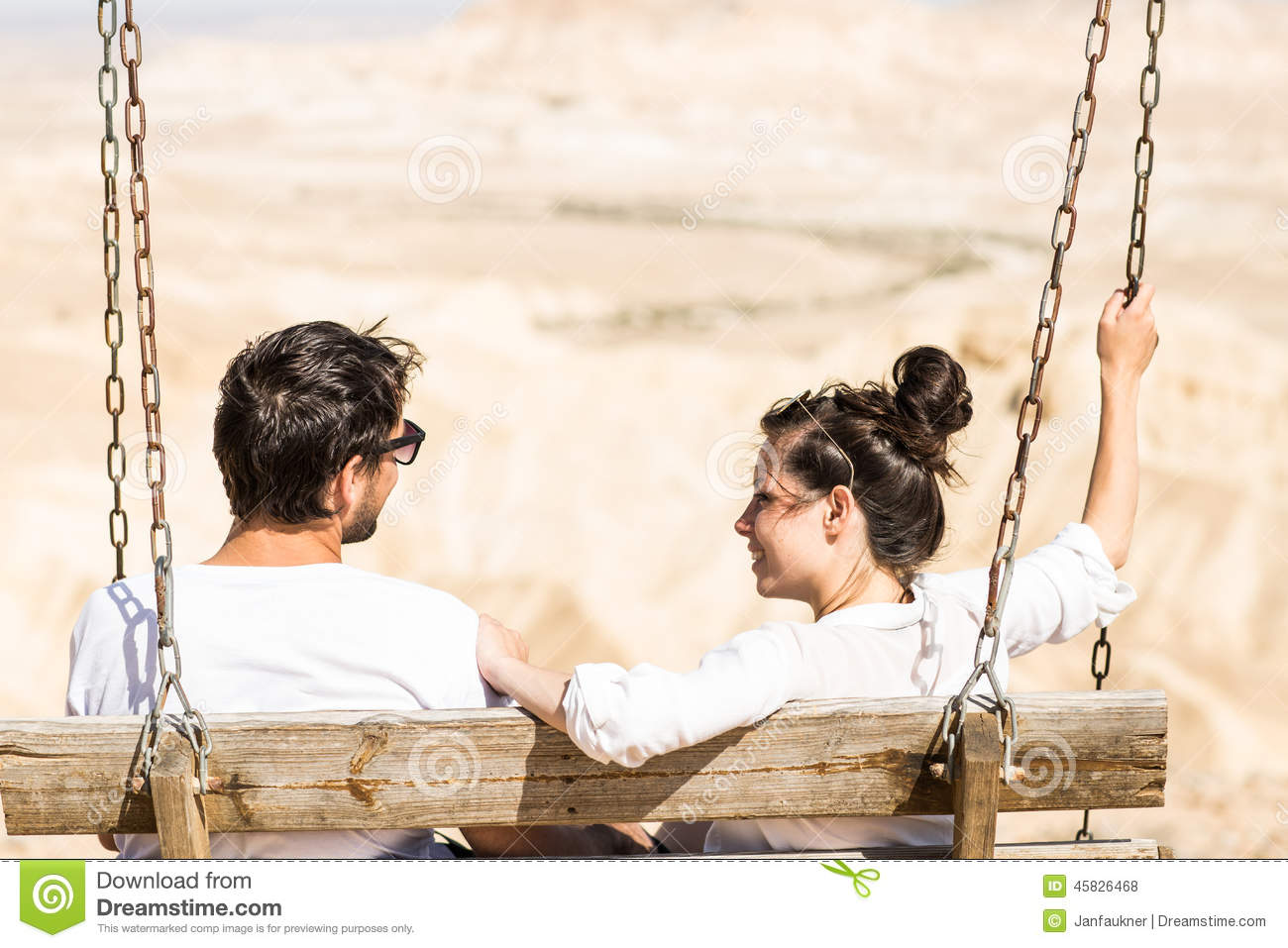 Couple sitting on the swing