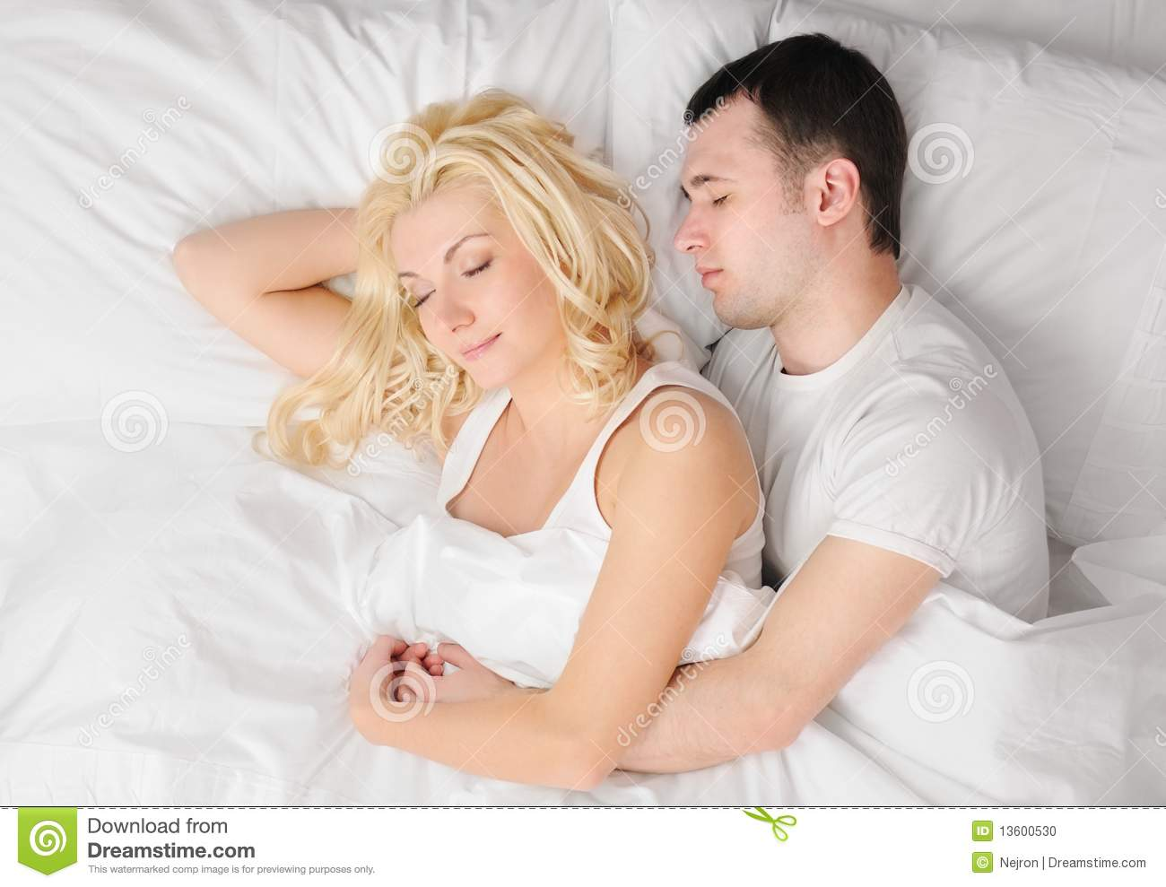 Couple Sleeping In A Bed Stock Photo - Image: 13600530