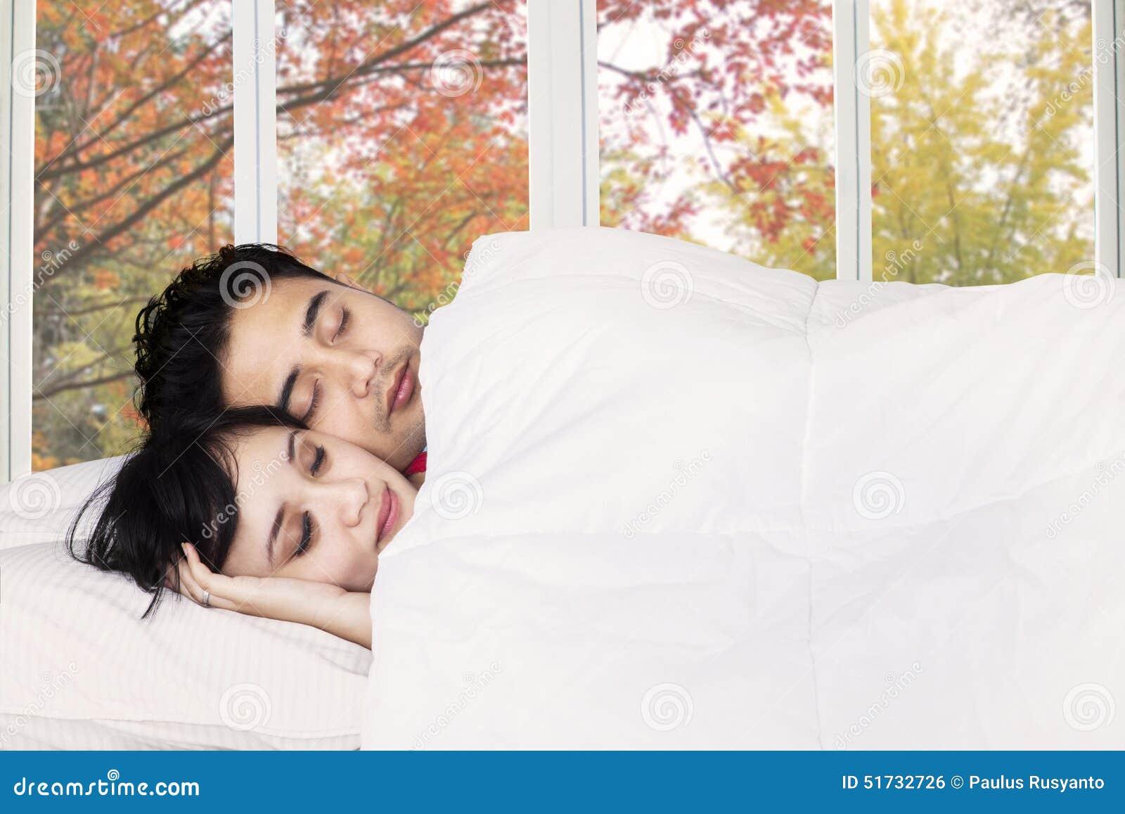 Asian couple in bedroom 8