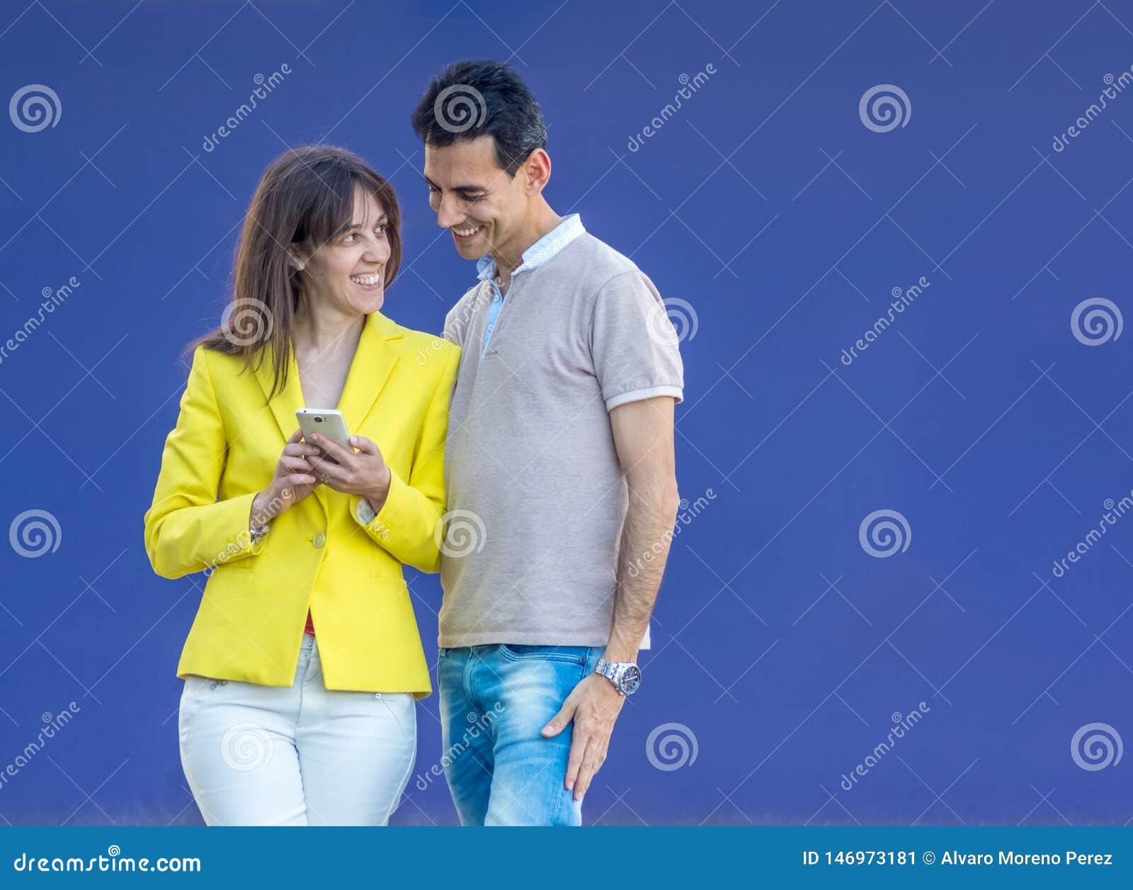 Couple smiling on blue background