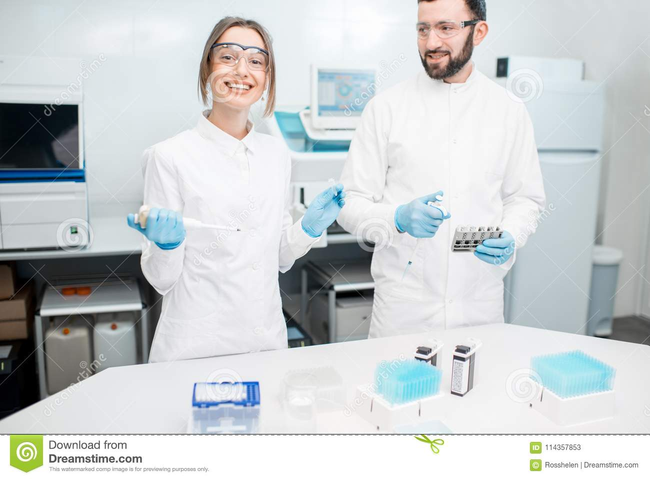 Laboratory assistants working with test tubes