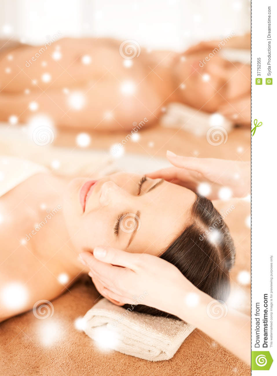Couple in spa salon getting face treatment royalty free for Health spa vacations for couples