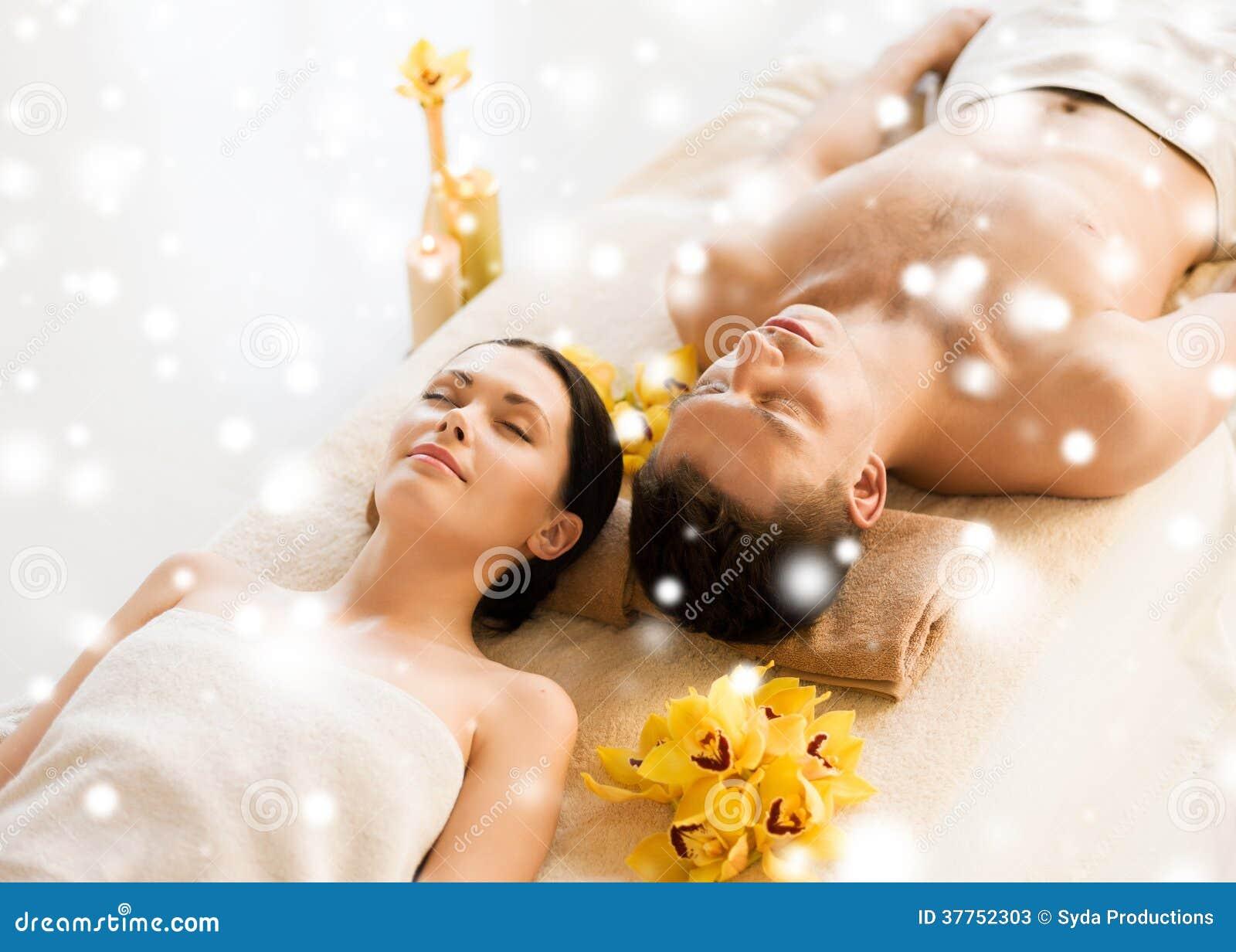 couple in spa salon lying on the massage desks stock photos image 37752303. Black Bedroom Furniture Sets. Home Design Ideas