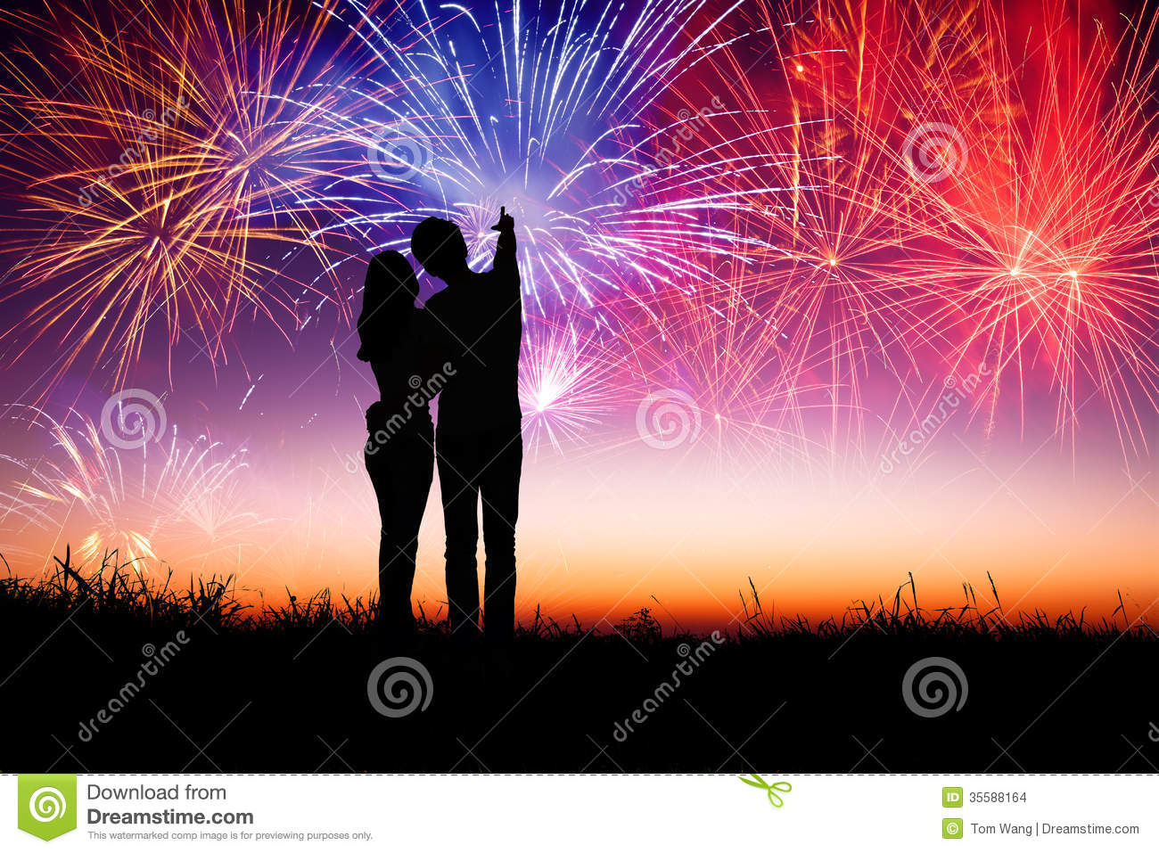 Couple Standing On The Hill And Watching The Fireworks