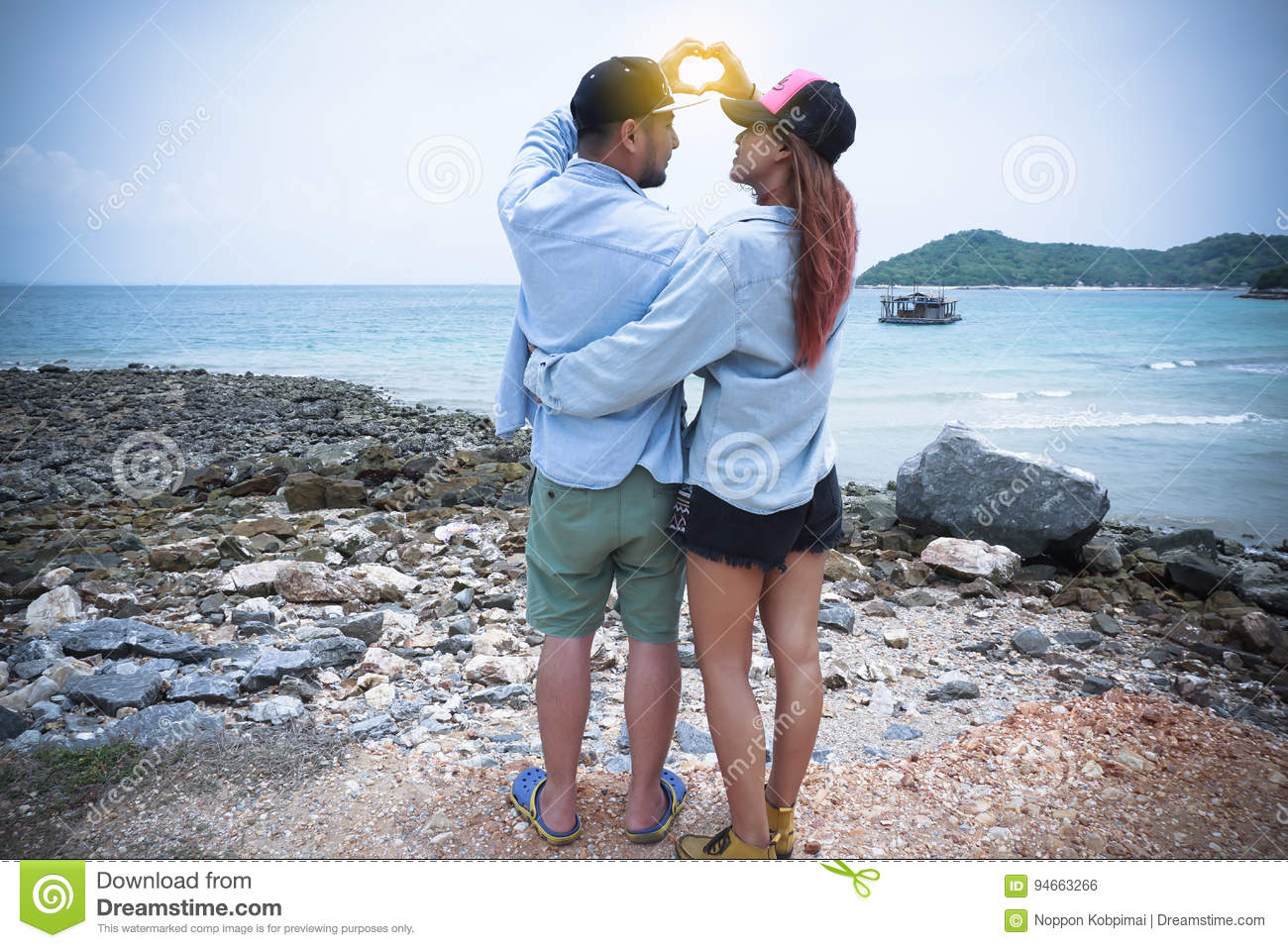 A couple standing hugging and look into each other eyes.