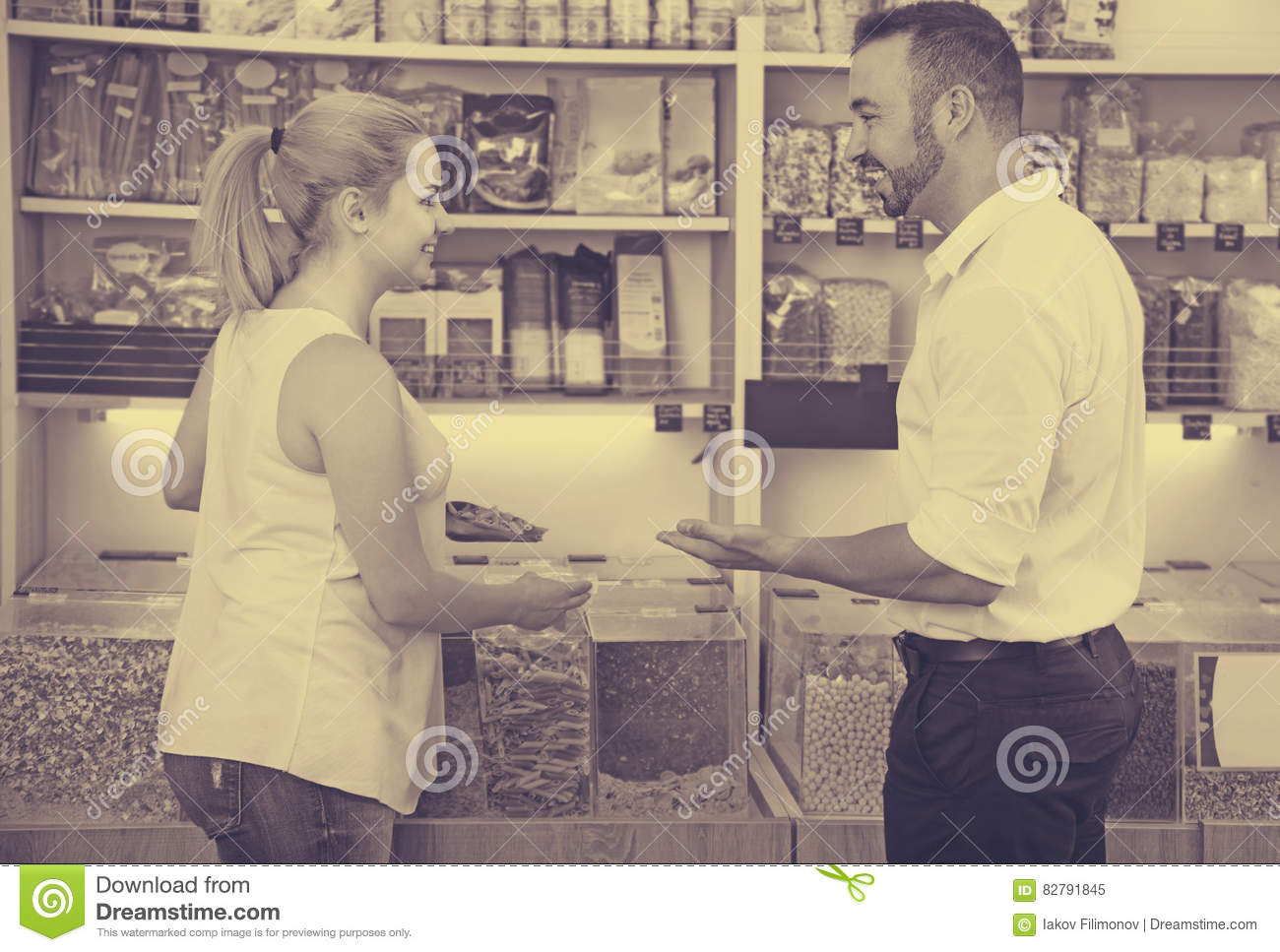 Young family couple selecting erotic photo in shop stock photo