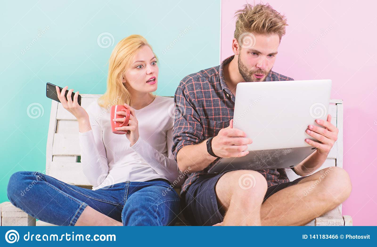 Couple surfing internet posting content social network. Shocking content. Couple content creators work with laptop and