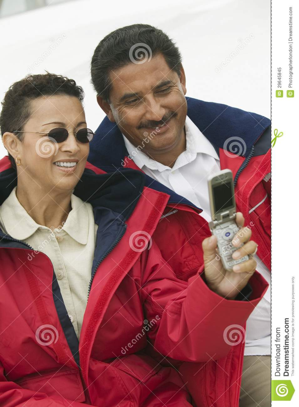 ... stock images of ` Couple Taking A Self Portrait Through Cell Phone