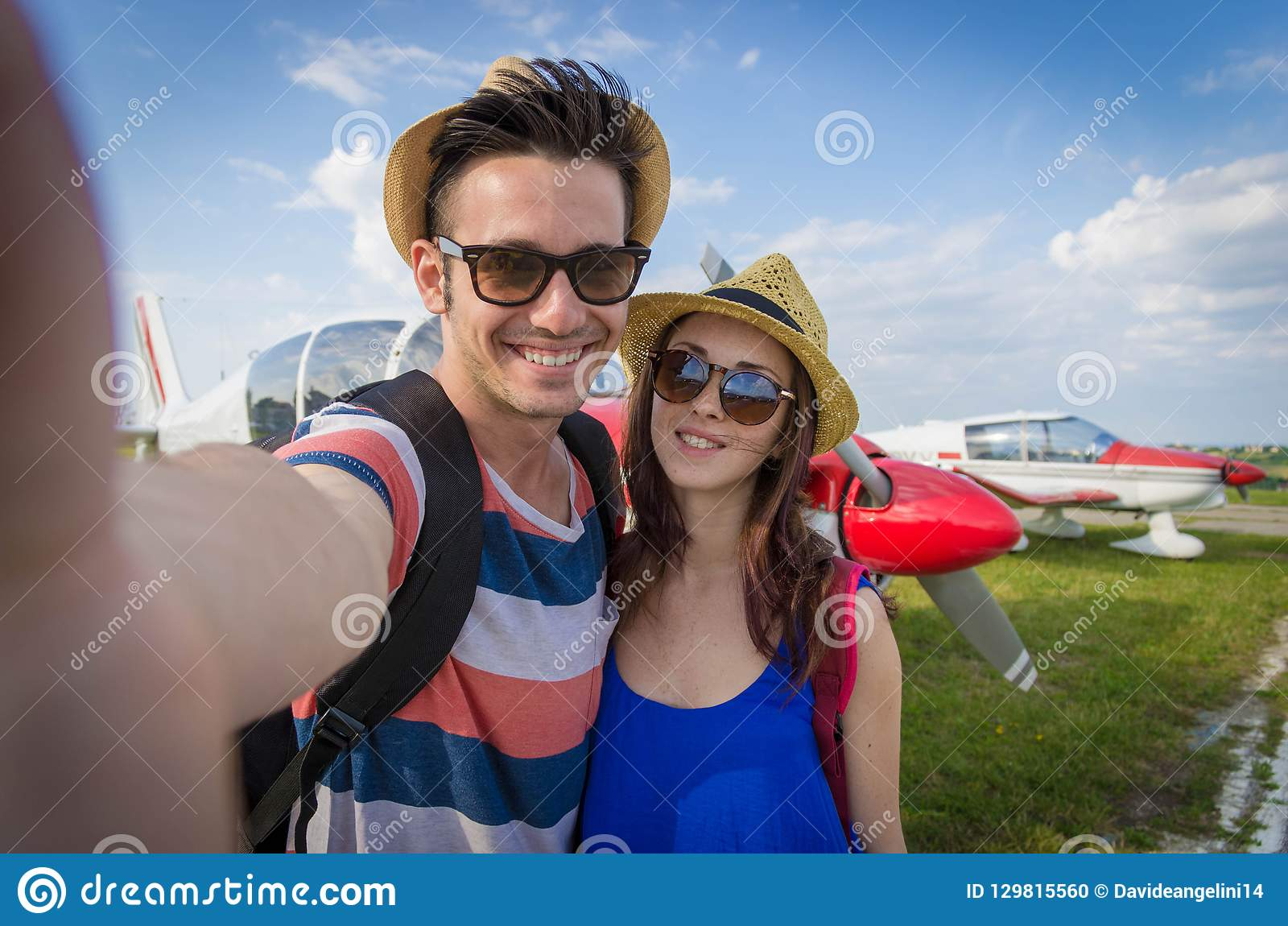 Couple taking a selfie at airport on vacation
