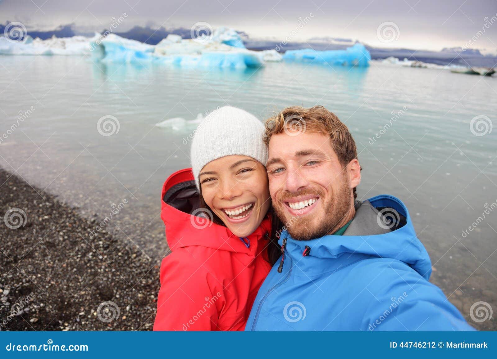 Couple taking selfie by Jokulsarlon on Iceland