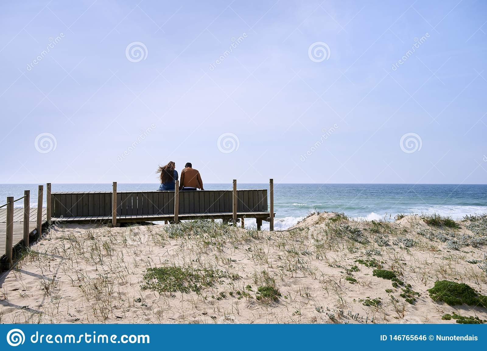 Couple talking near the beach