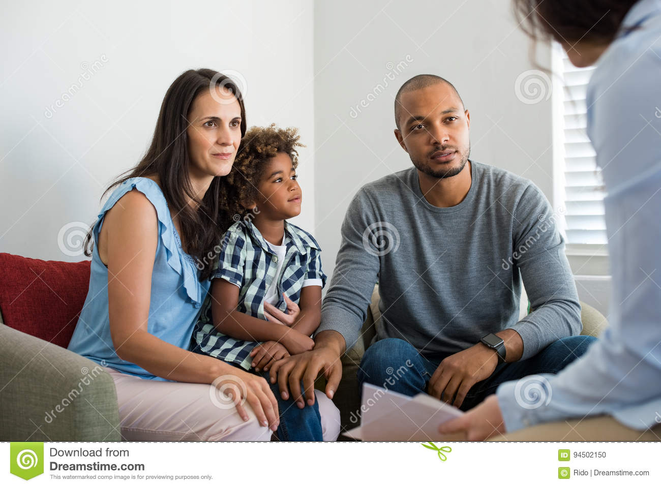 Couple talking to family counselor