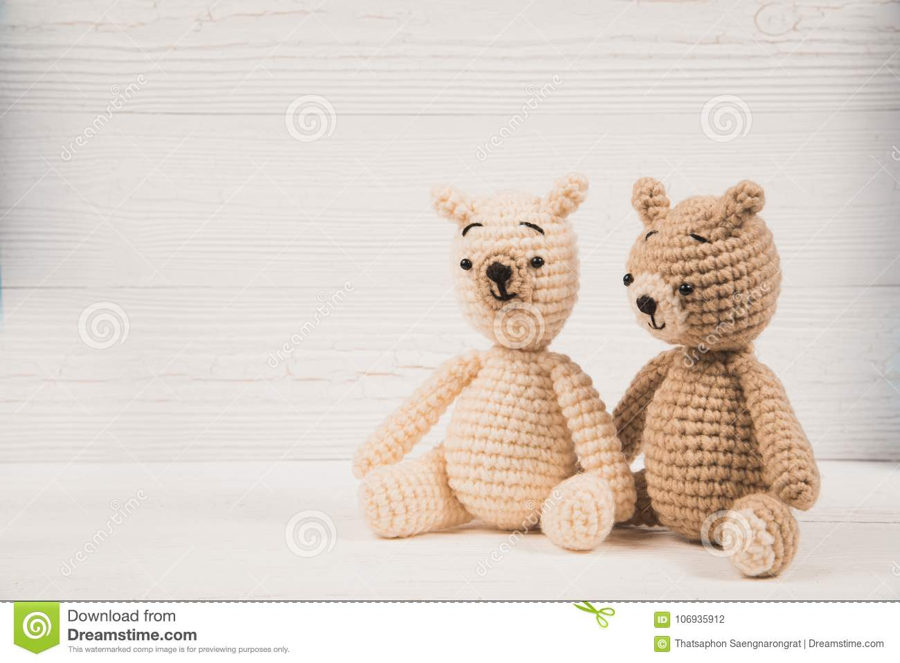 Couple teddy bear with red heart crochet knitting handmade, love and valentine concept.
