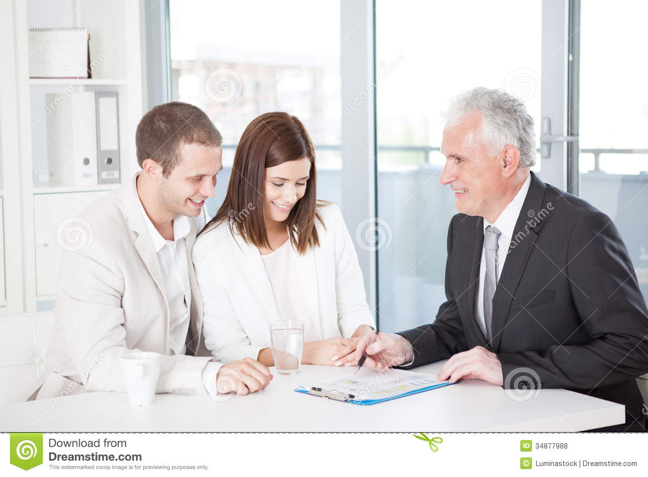 Couple With Their Financial Advisor Royalty Free Stock Photos ...