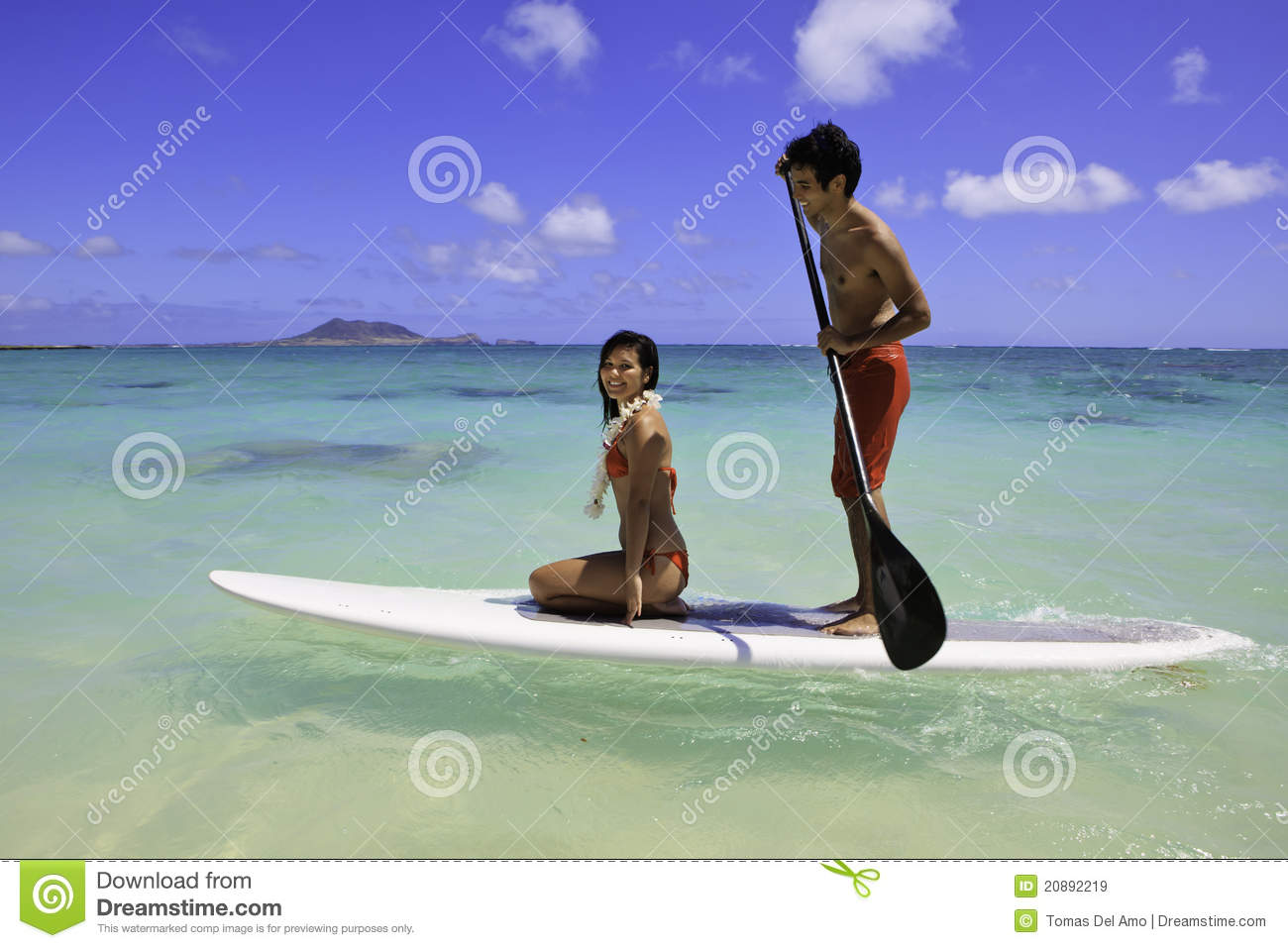 Couple with their paddle board