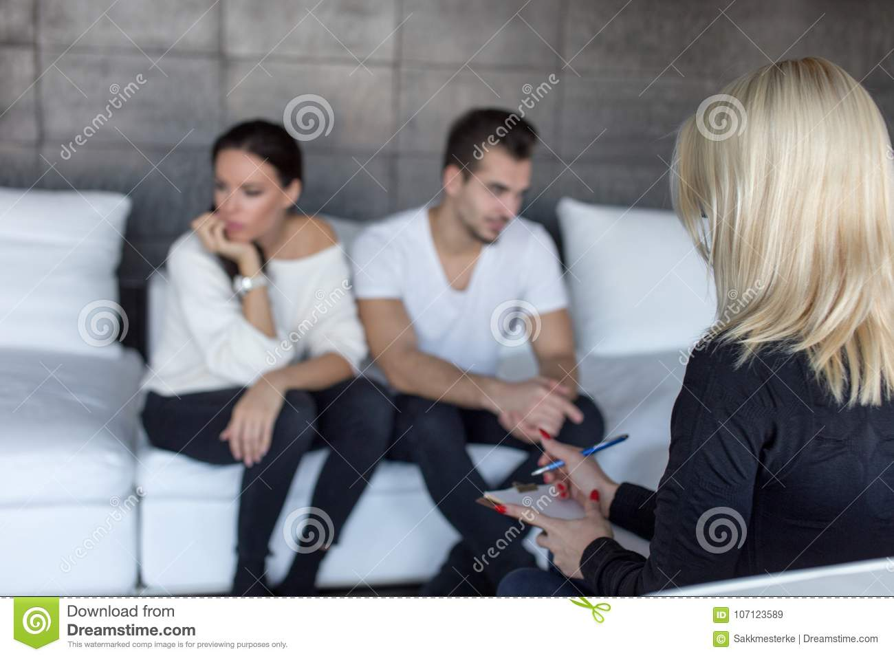 Couple Therapist Writing Down Situation On Therapy Stock Image