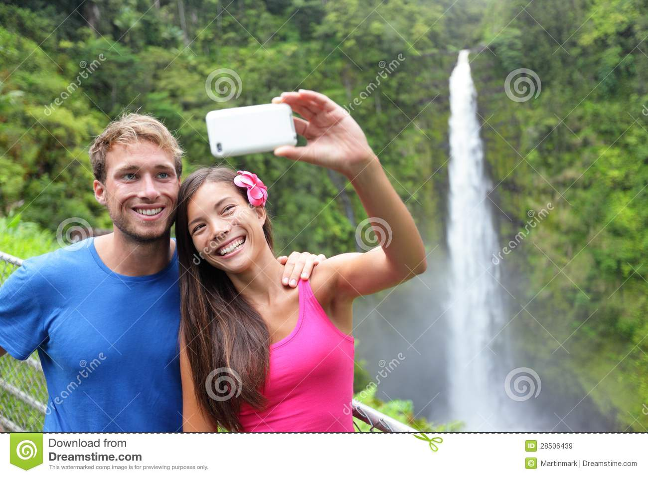 Couple tourists taking self portrait on Hawaii