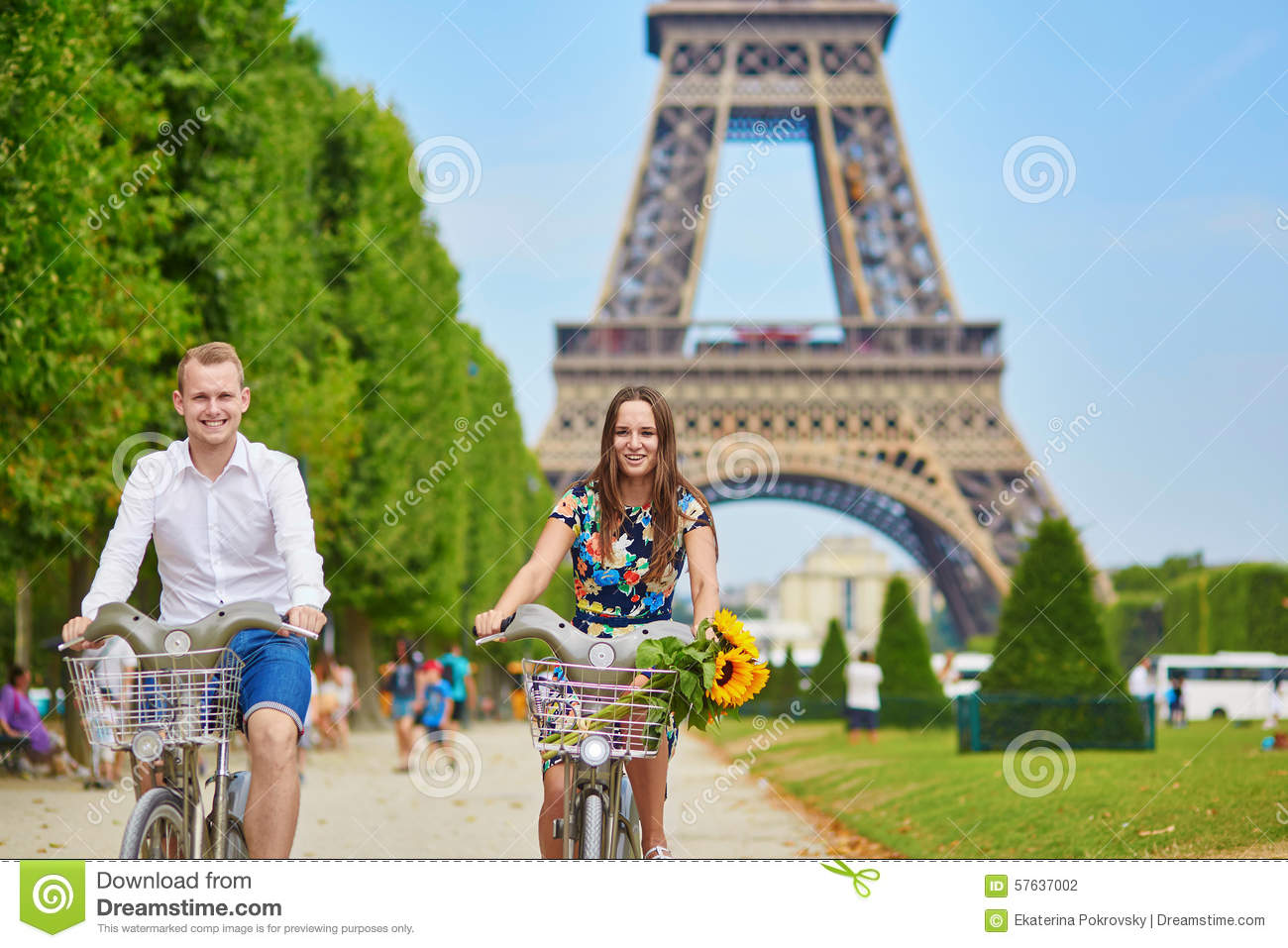 Couple of tourists using bicycles in Paris, France