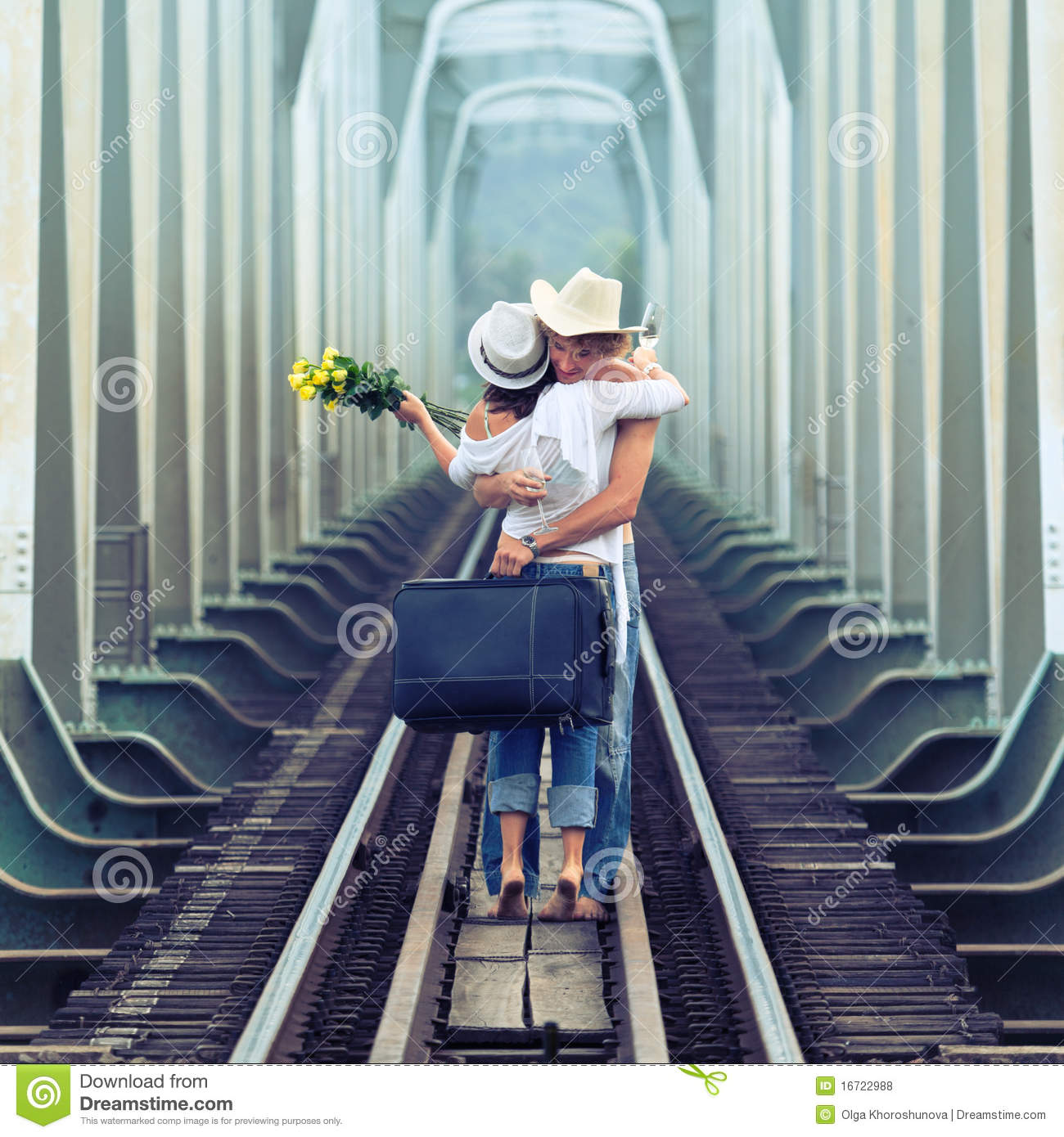 Couple on train tracks