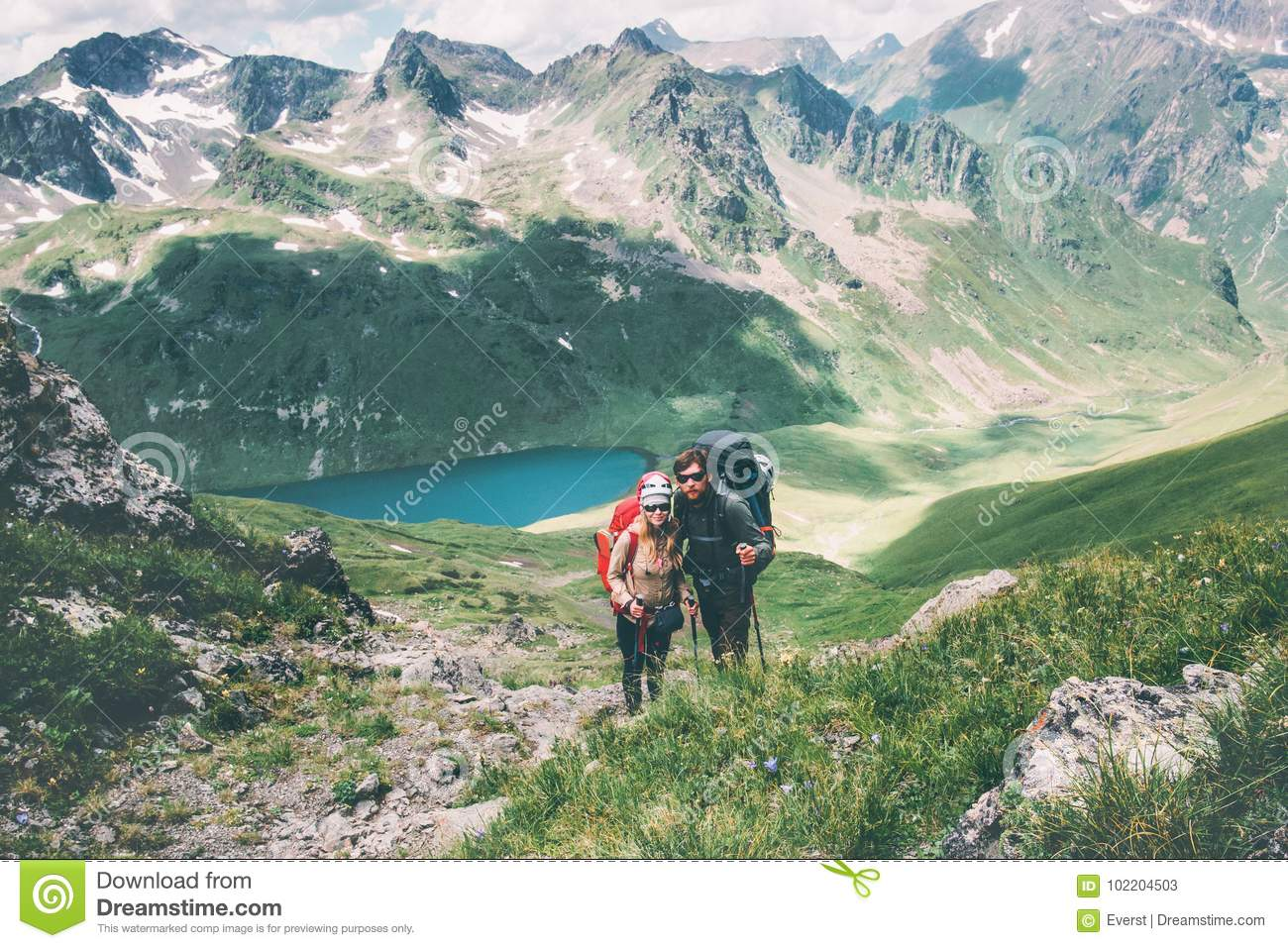 Couple travelers Man and Woman climbing in mountains Love and Travel happy emotions Lifestyle concept. Young family