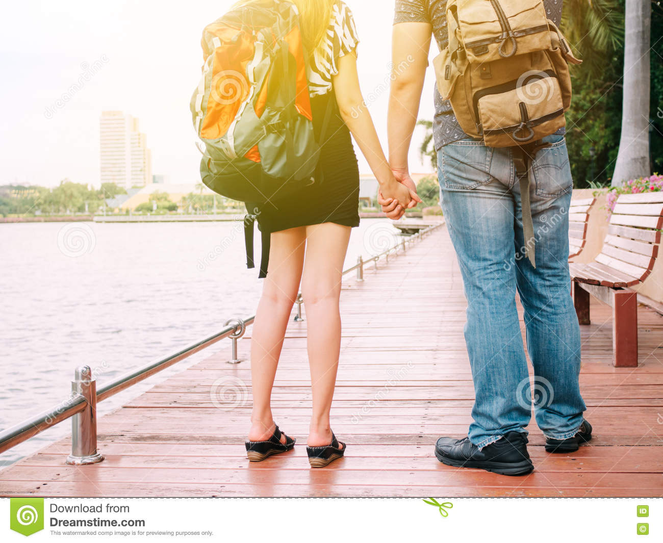 Beautiful Traveling Couple Holding Hands In The Park ...