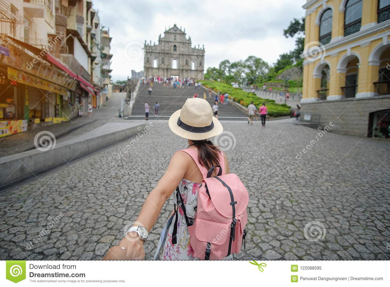 Asian hipster traveler looking to Ruins of St. Paul`s