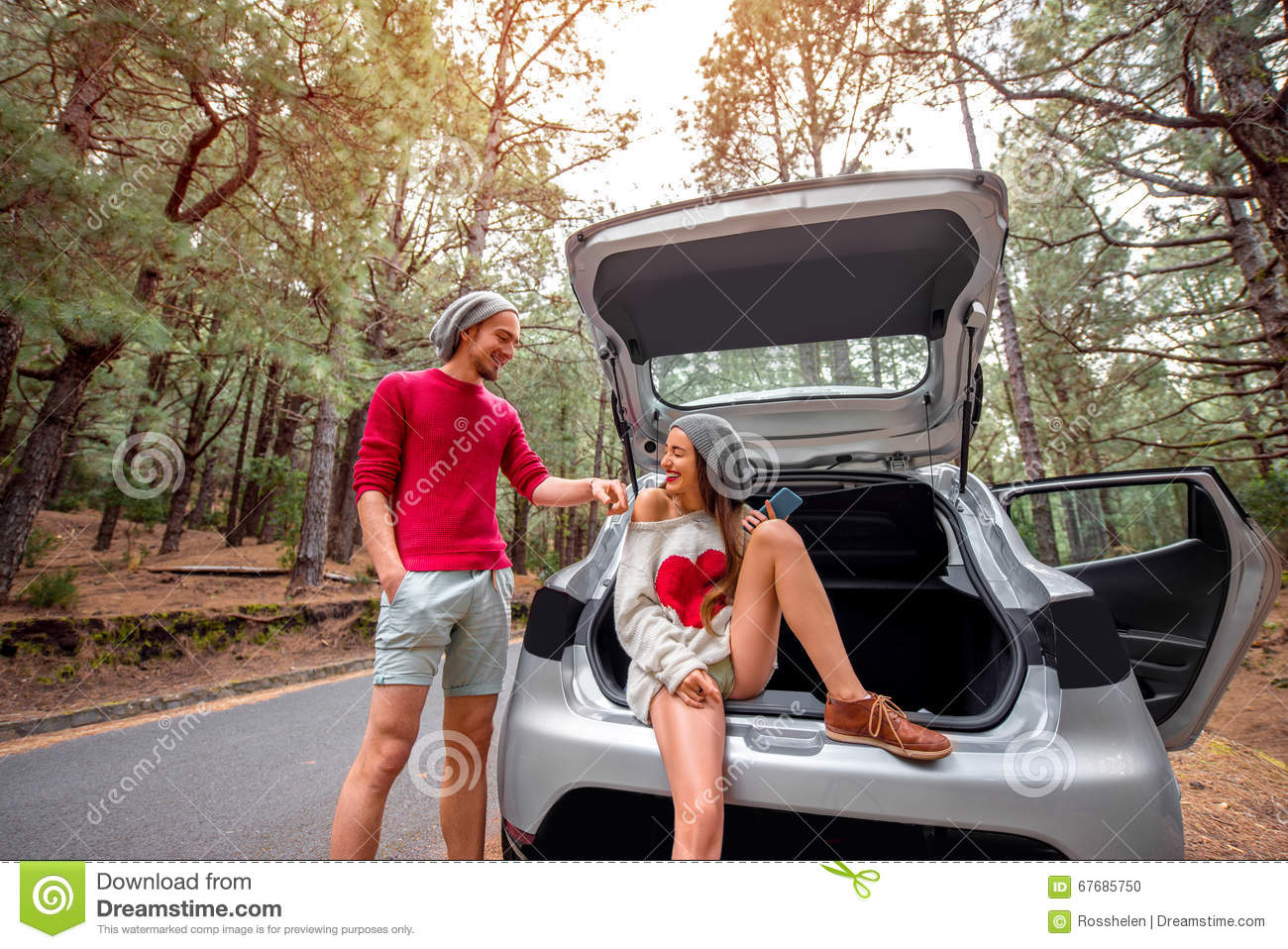 Couple Traveling By Car In The Forest Stock Photo Image Of Outdoors Happy 67685750