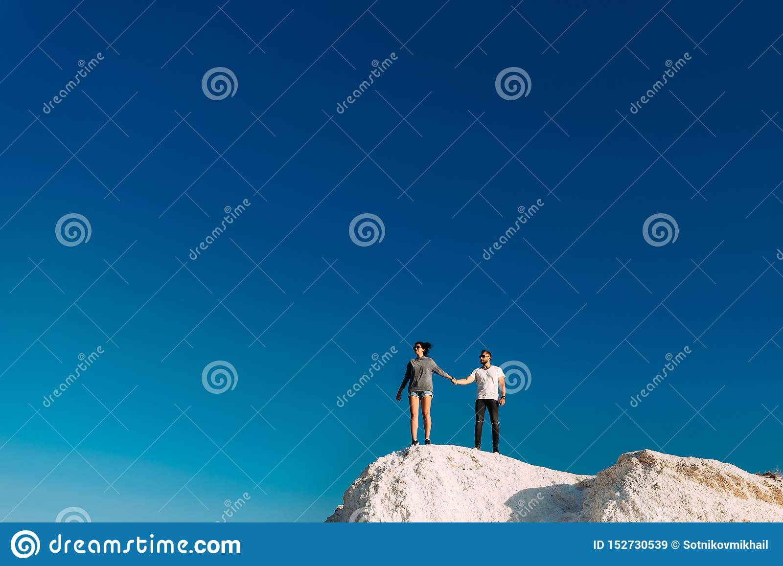 Couple travels. Man and woman standing on the mountain. A couple in love travels. A couple in Turkey. Honeymoon trip. Outdoor