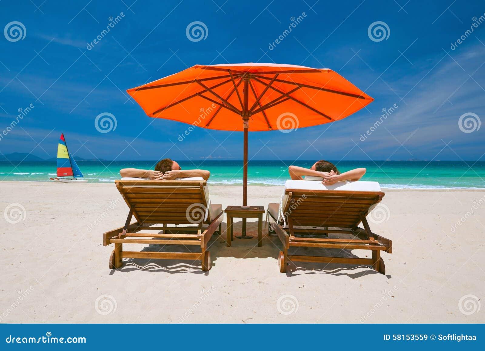 Tropical Beach Chairs Couple On A Tro...