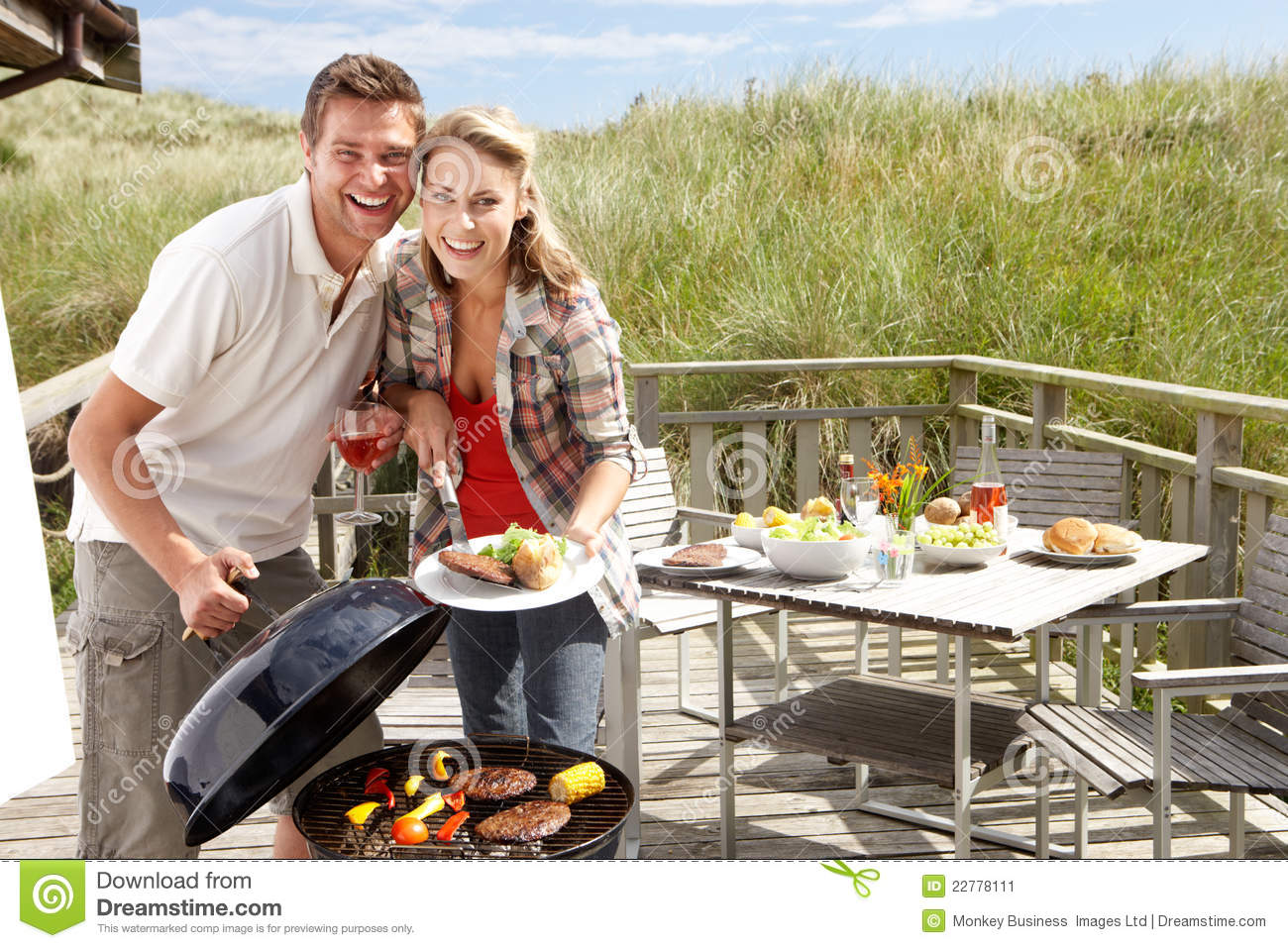 22fdf6300f1 Couple On Vacation Having Barbecue Stock Image - Image of chalet ...