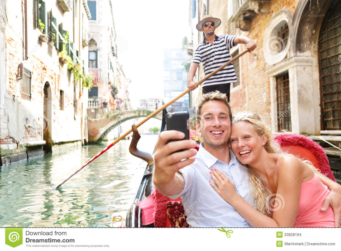 Couple in venice on gondole ride romance stock images for Where to go in michigan for a romantic weekend