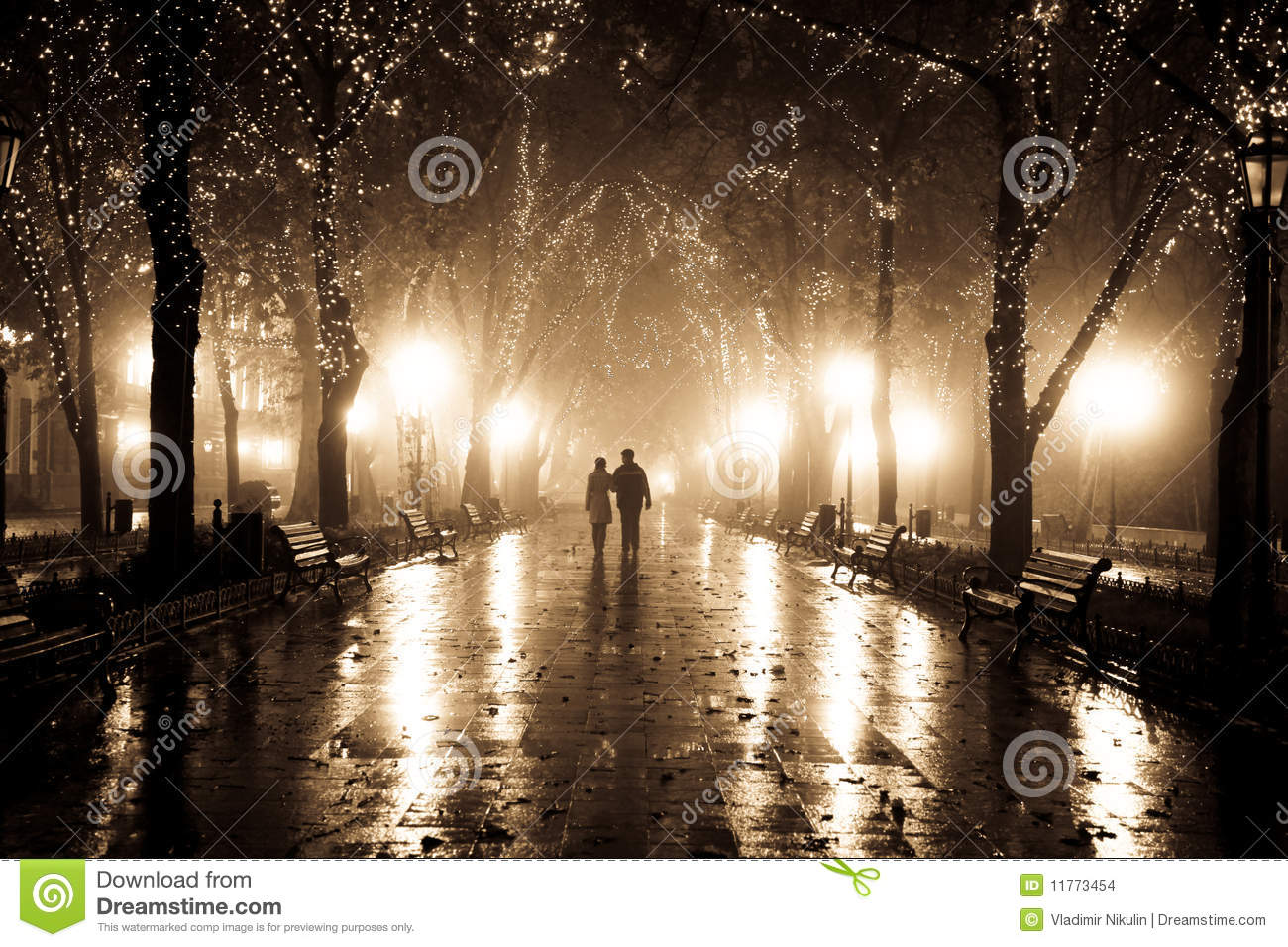 Couple Walking At Alley In Night Lights Stock Photo