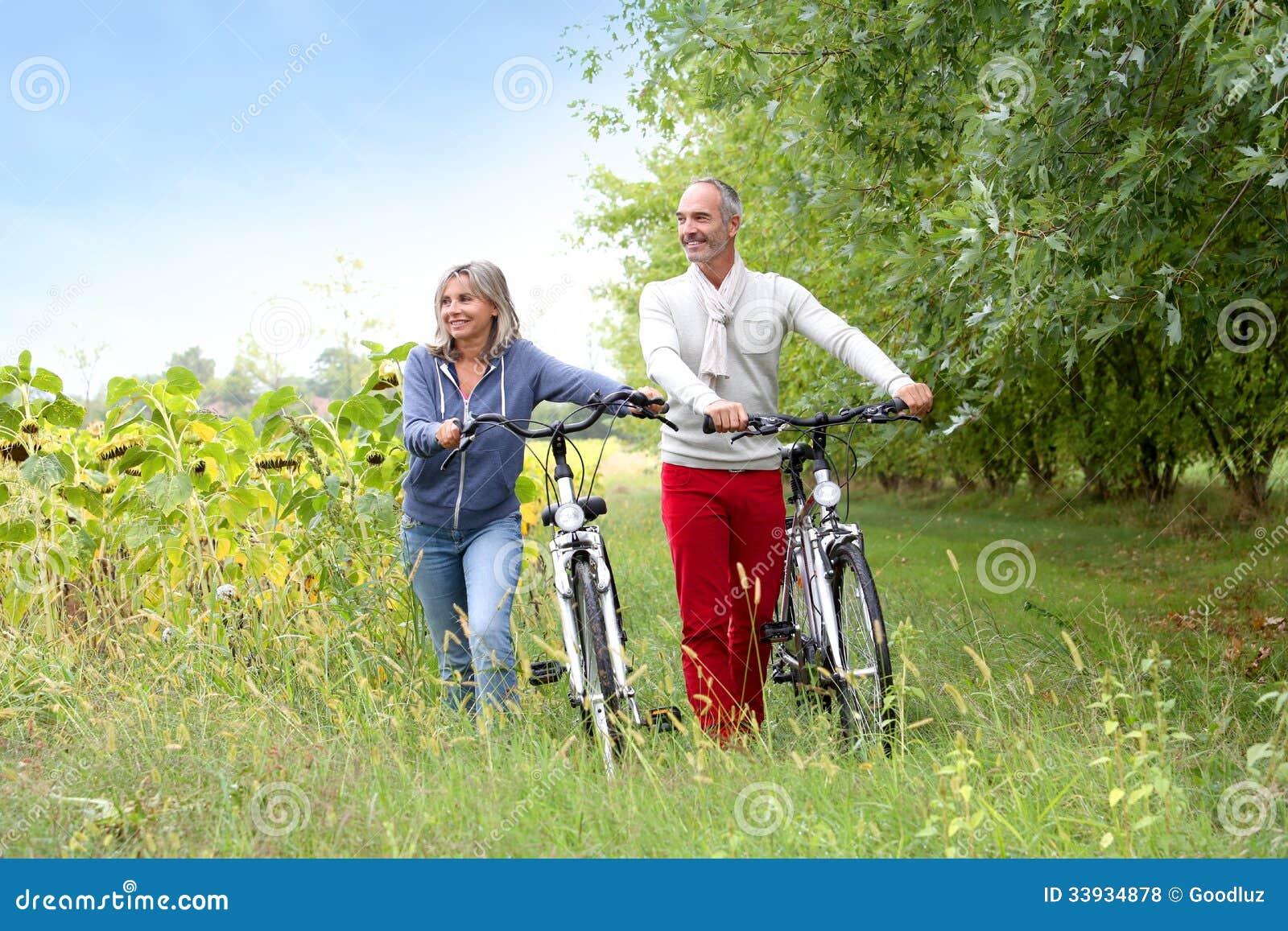 senior couple walking together on sunny day royalty free